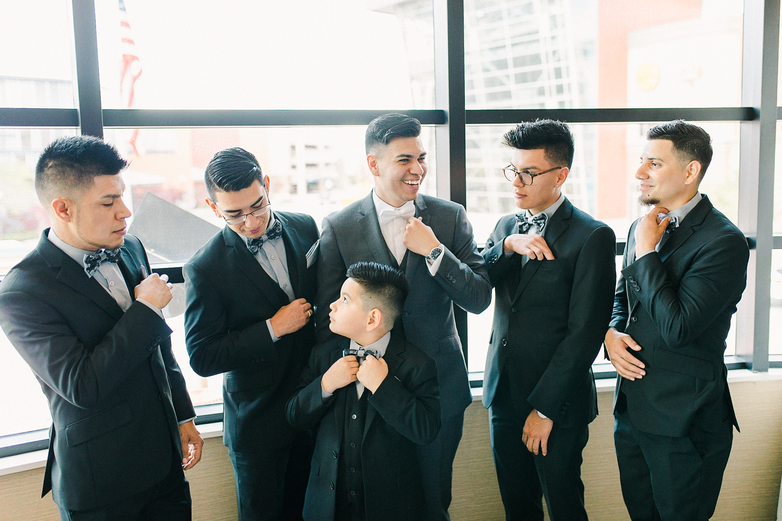 Cache Valley Logan Traditional Catholic Wedding Ceremony in a cathedral, Utah wedding photography, groom and groomsmen getting ready photos