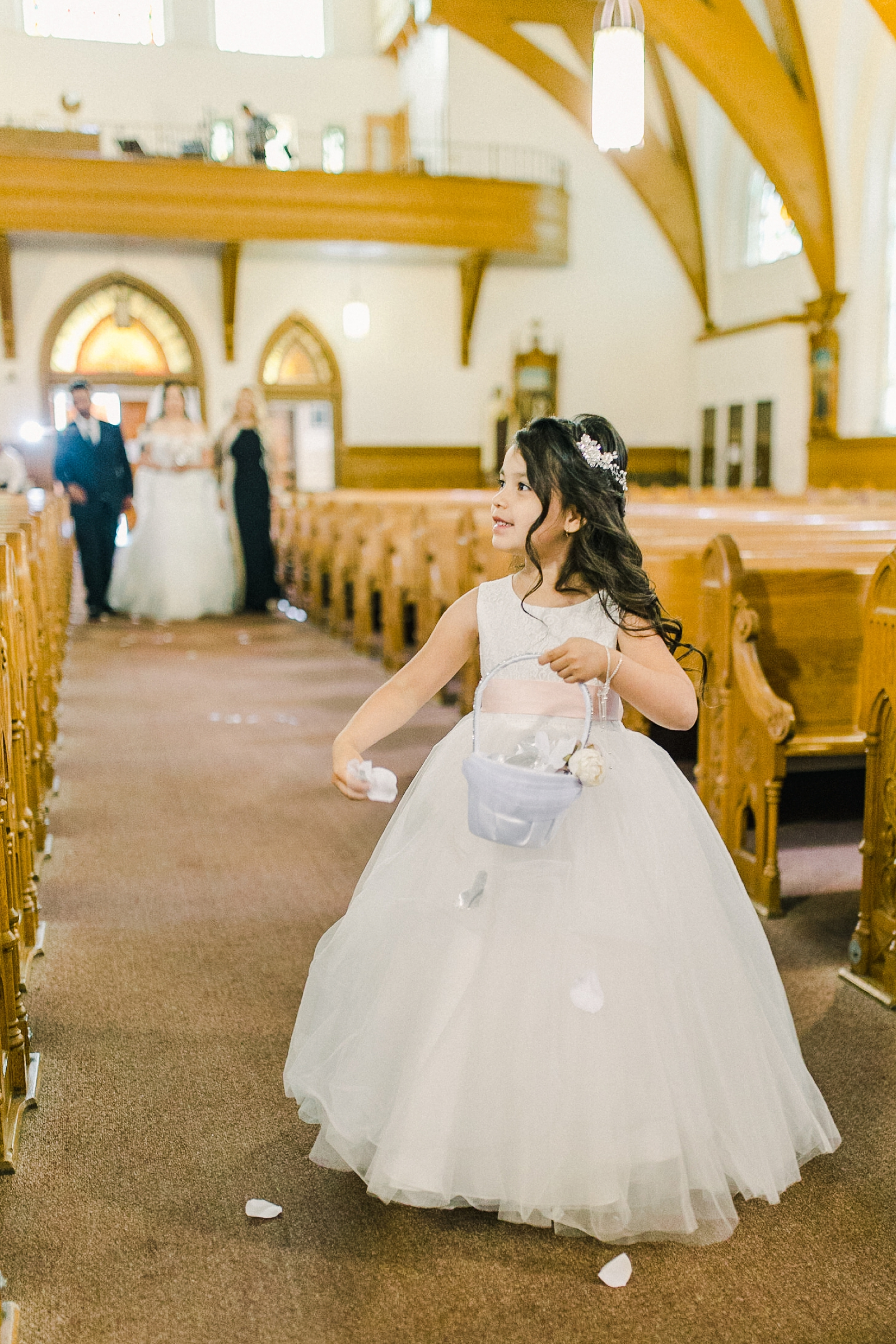 Cache Valley Logan Traditional Catholic Wedding Ceremony in a cathedral, Utah wedding photography, flower girl sprinkle petals