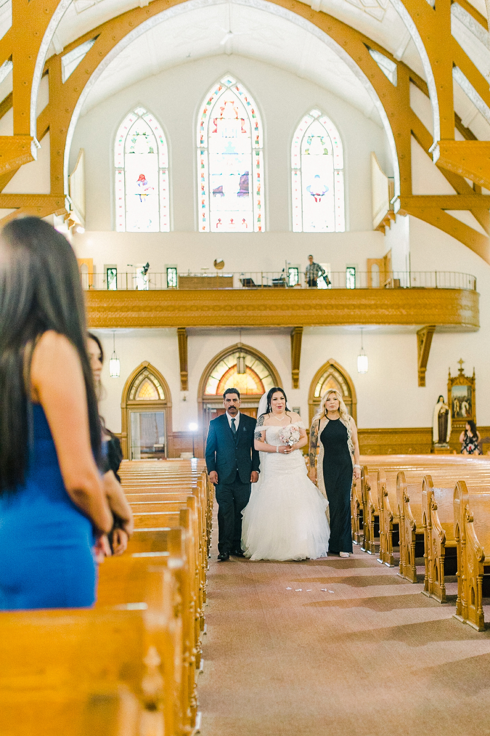 Cache Valley Logan Traditional Catholic Wedding Ceremony in a cathedral, Utah wedding photography, bride walks down the aisle