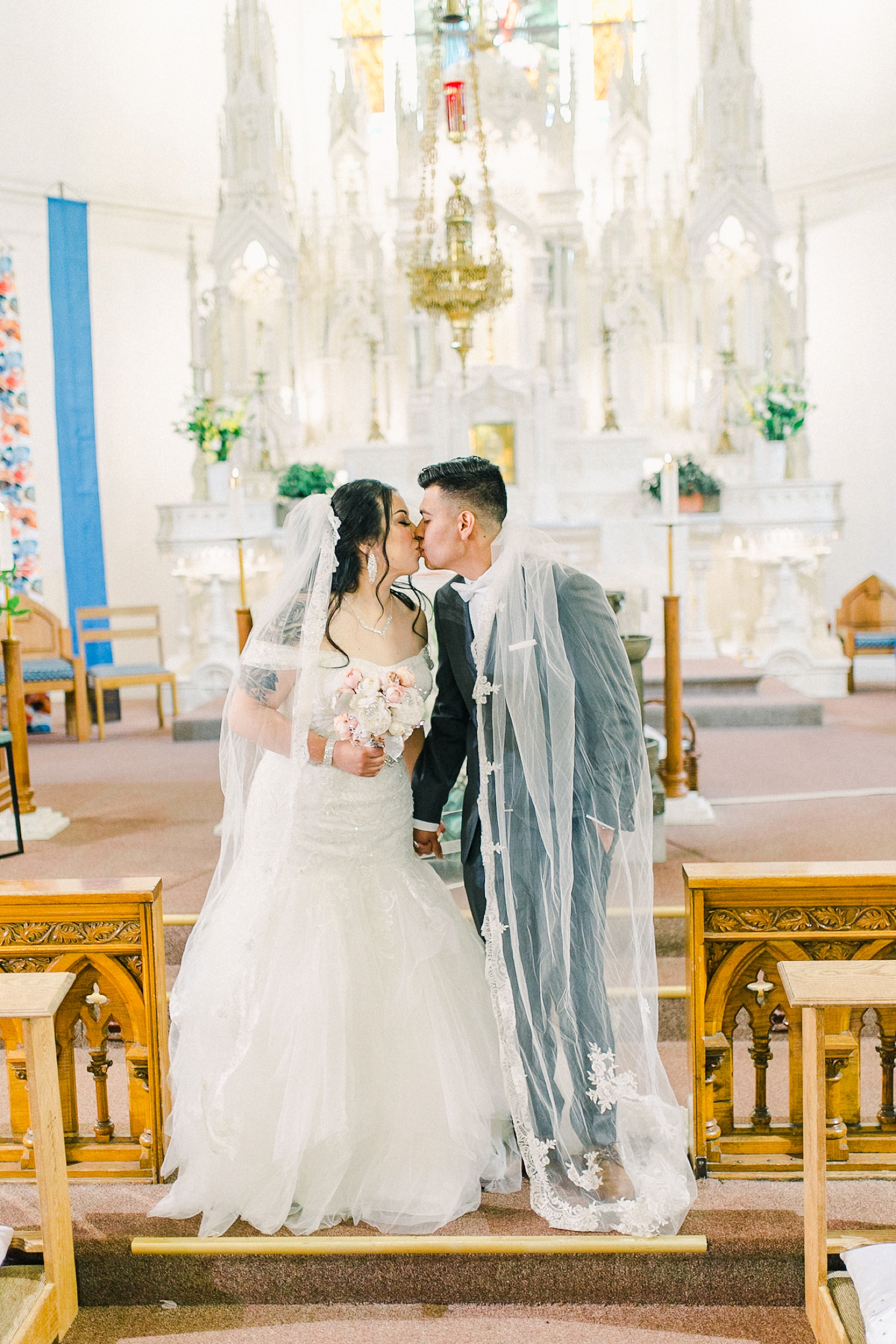 Cache Valley Logan Traditional Catholic Wedding Ceremony in a cathedral, Utah wedding photography, first kiss