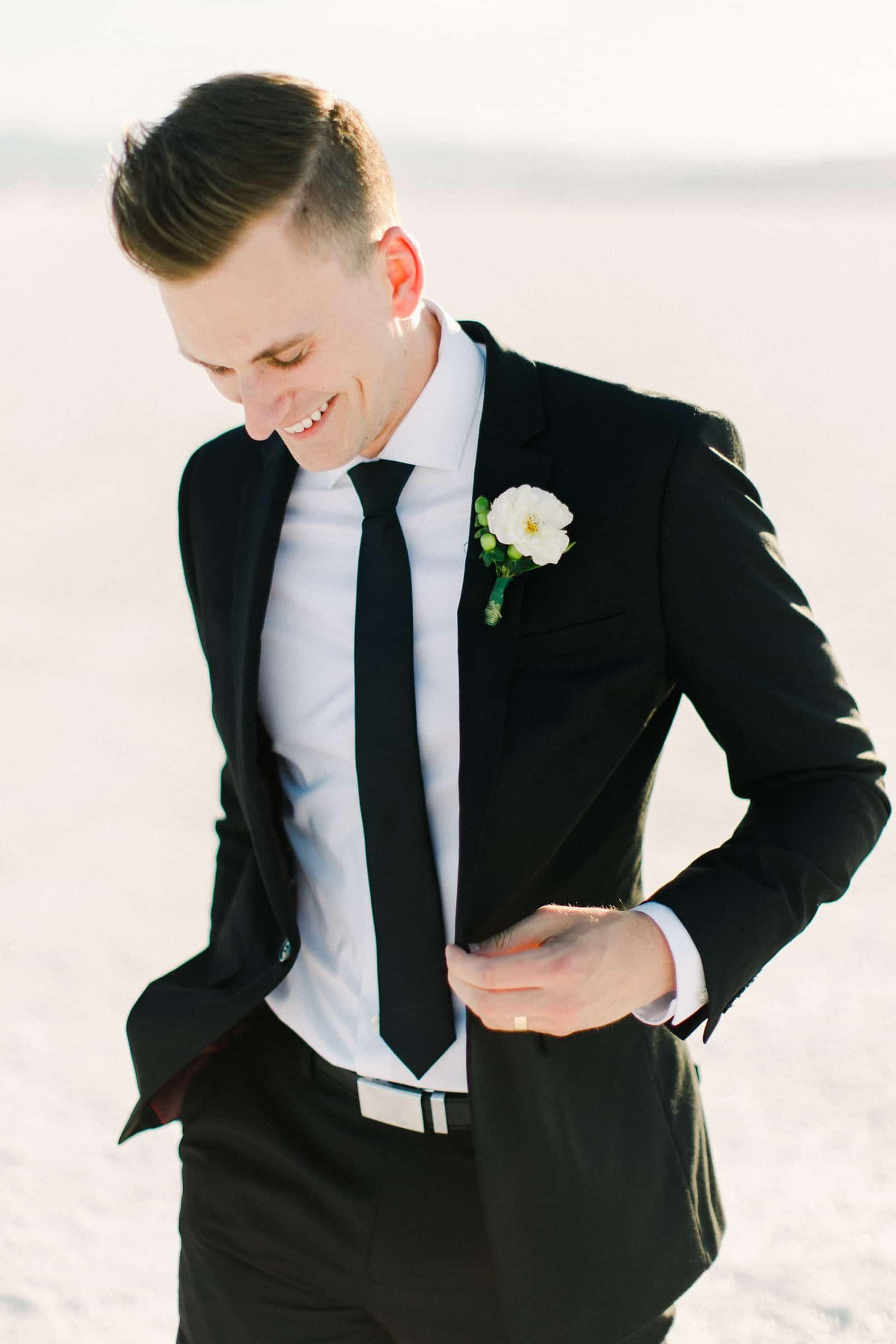 Bonneville Salt Flats Utah Wedding Photography, destination wedding, groom smiling in classic black suit and black tie