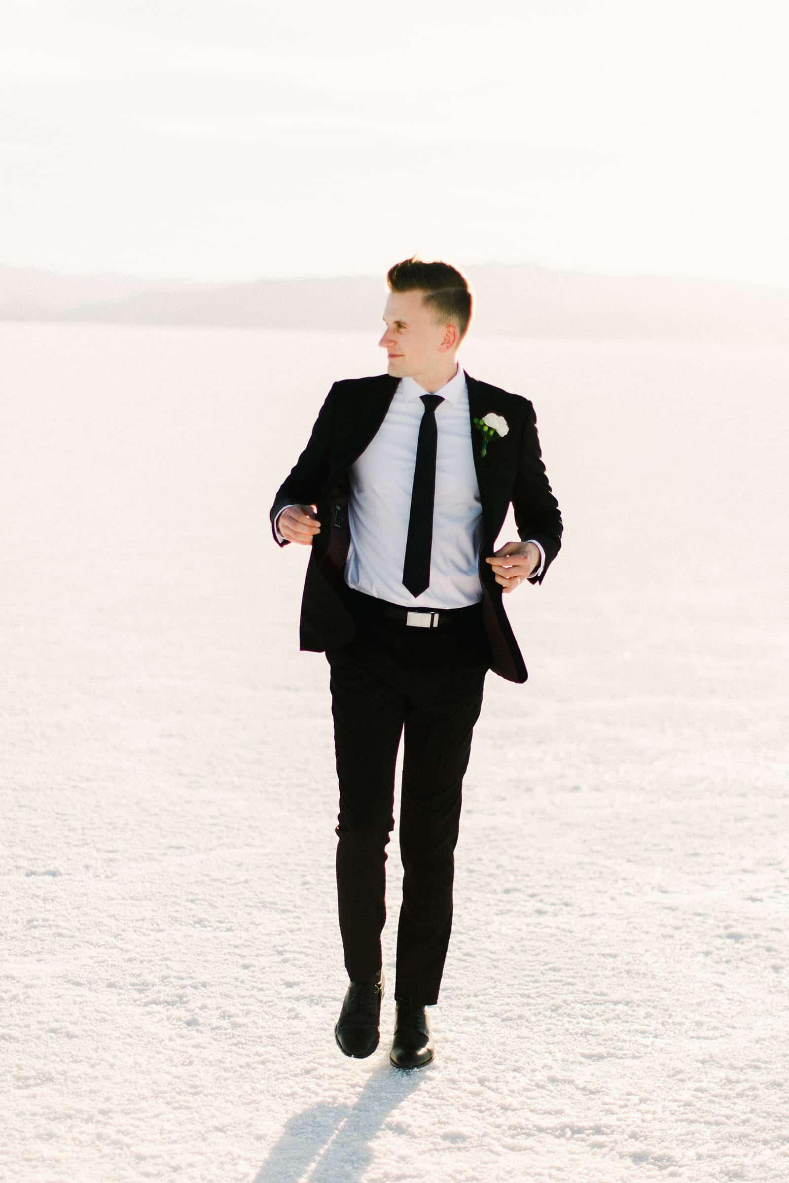Bonneville Salt Flats Utah Wedding Photography, destination wedding, groom in classic black suit and black tie