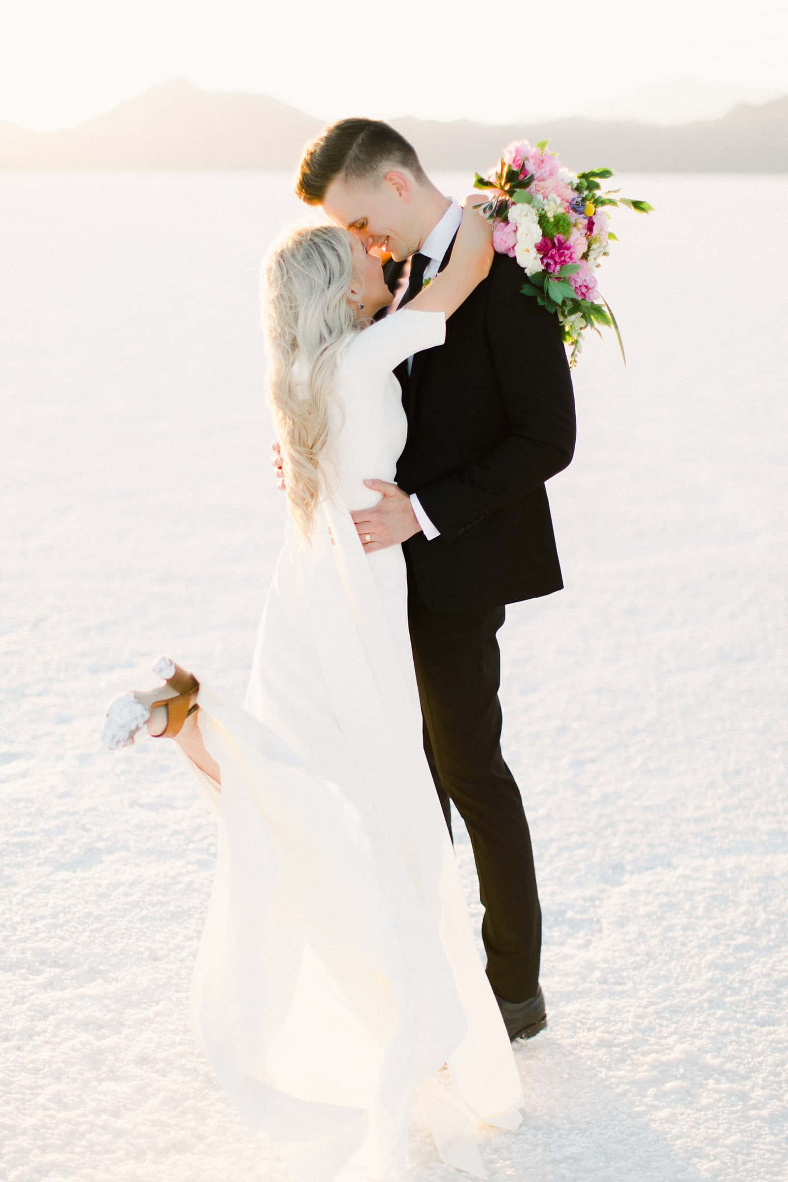 Bonneville Salt Flats Utah Wedding Photography, destination wedding, bride snd groom kiss