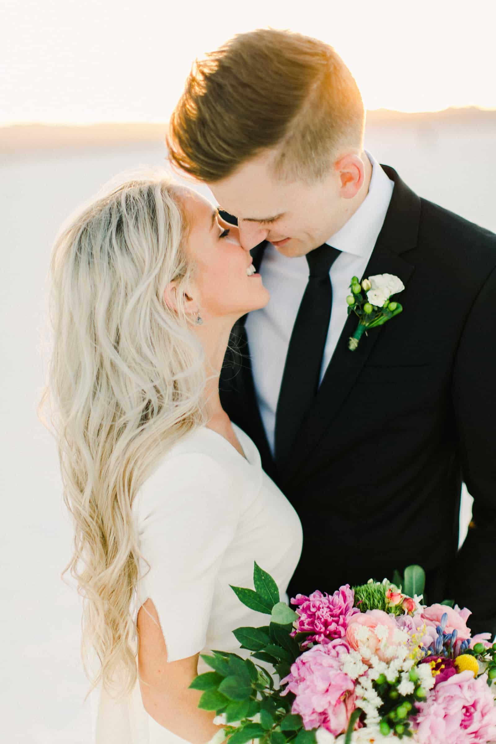 Bonneville Salt Flats Utah Wedding Photography, destination wedding, bride and groom first kiss