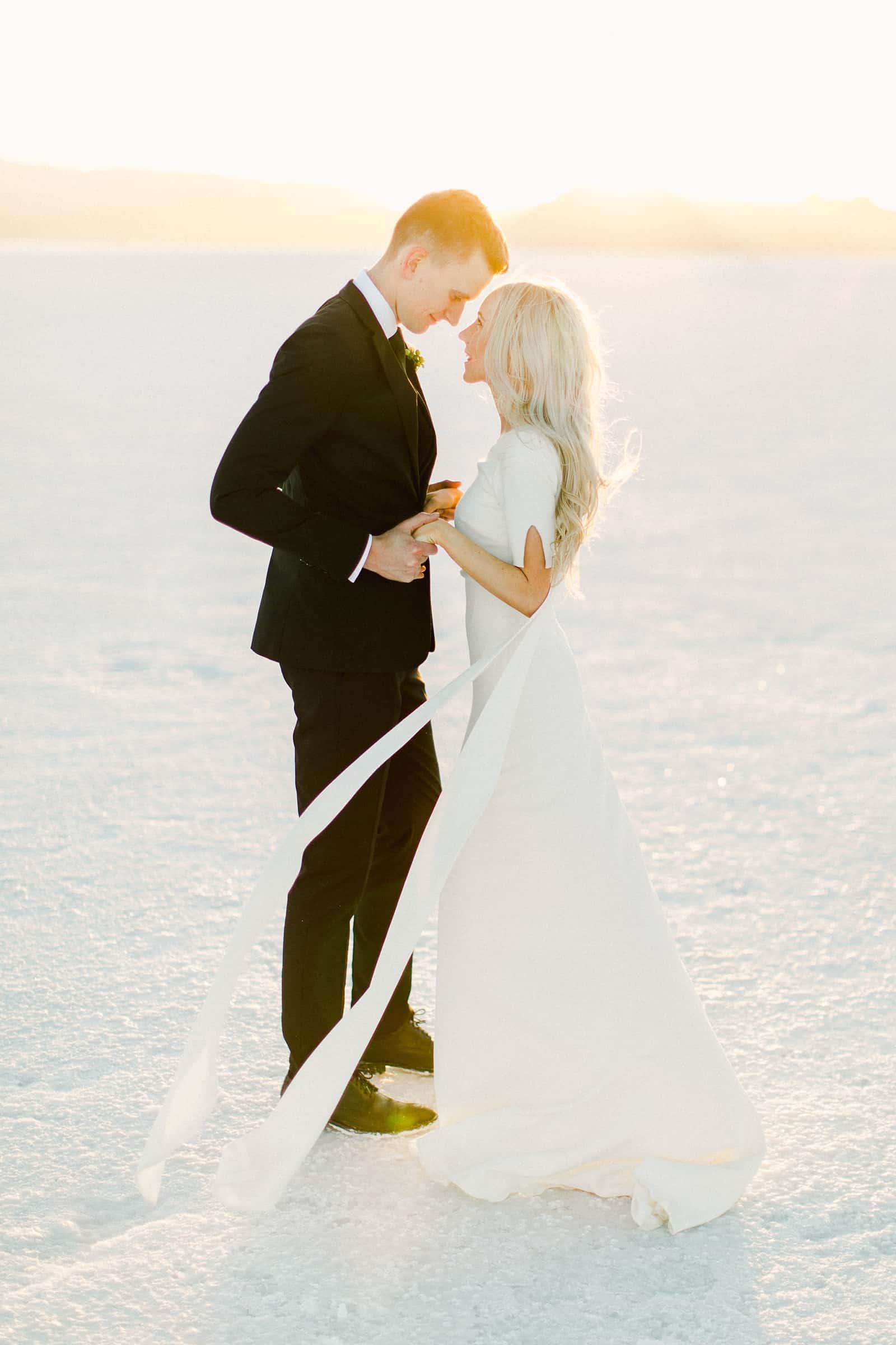 Bonneville Salt Flats Utah Wedding Photography, destination wedding, modern bride and groom golden light