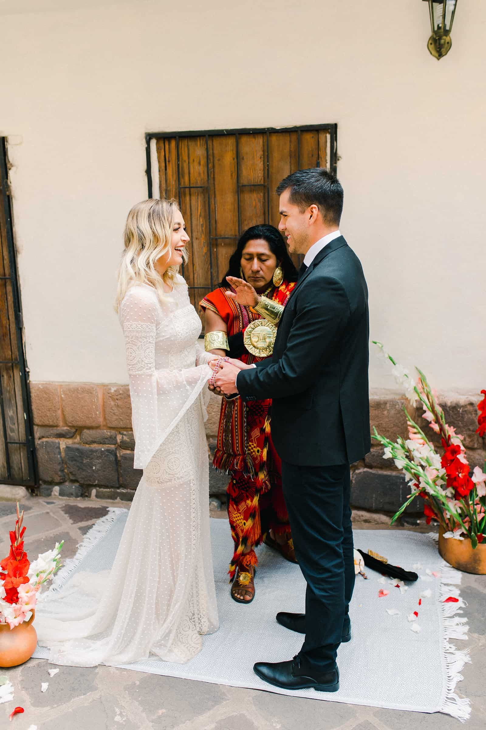 Cusco Peru Destination Wedding, travel wedding photography, Plaza de Armas ceremony with shaman boho wedding