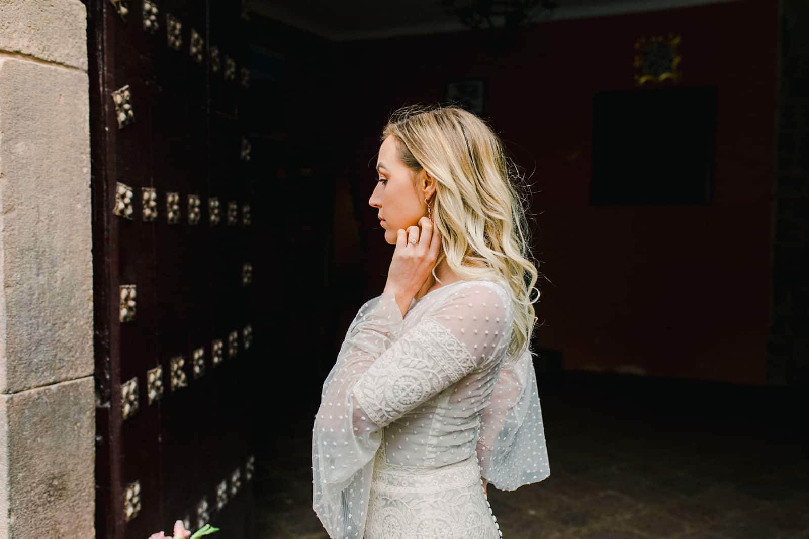 Cusco Peru Destination Wedding, travel wedding photography, boho bride lace dress with bell sleeves