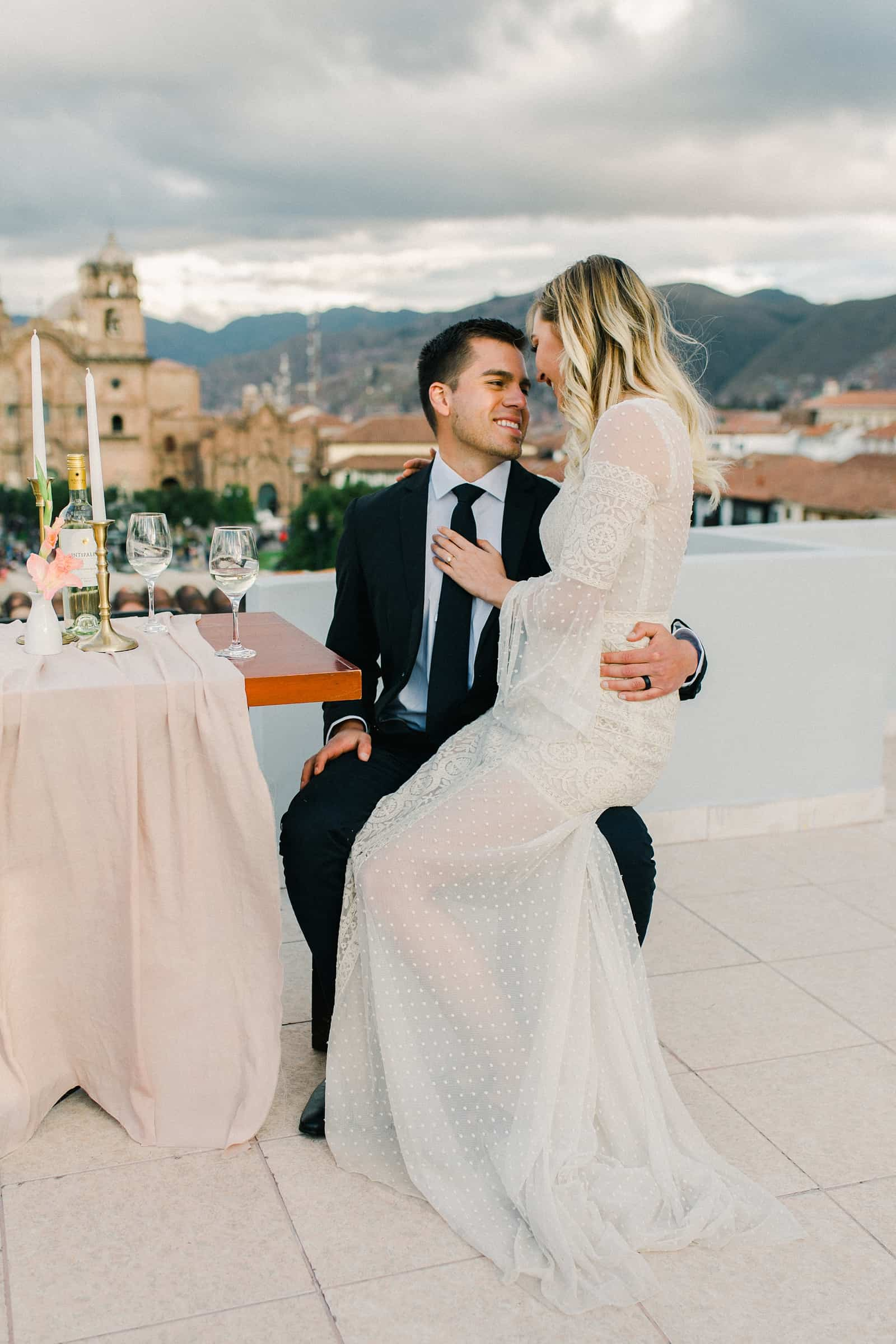Cusco Peru Destination Wedding Inspiration, travel photography, bride and groom wedding dinner overlooking Cusco Cathedral