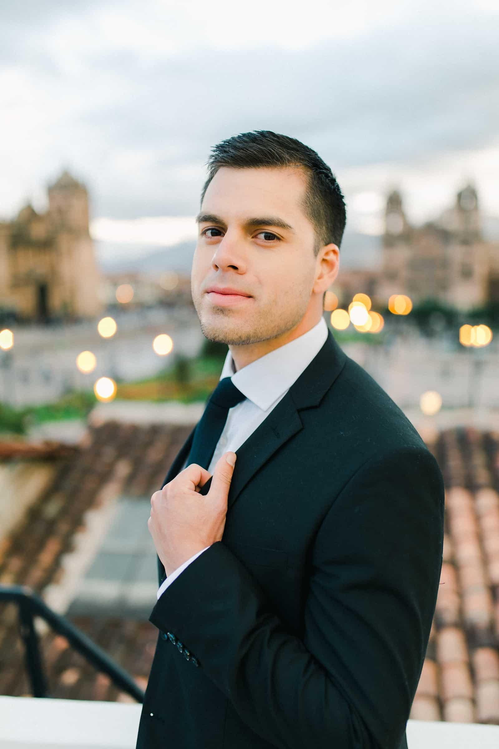 Cusco Peru Destination Wedding Inspiration, travel photography, groom in classic black suit tux with black tie