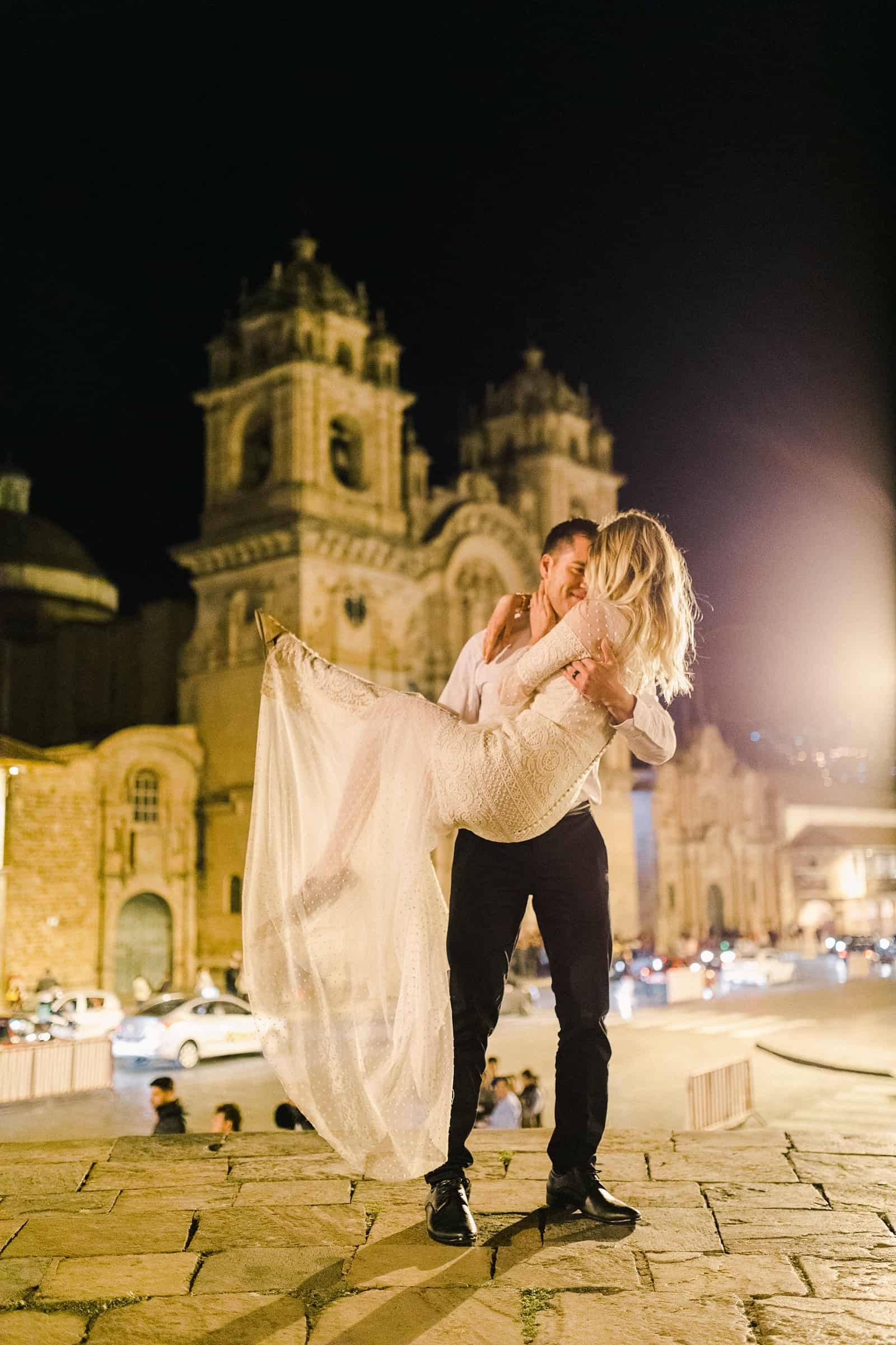 Cusco Peru Destination Wedding Inspiration, travel photography, bride and groom dance in front of Cusco Cathedral at Plaza de Armas at night