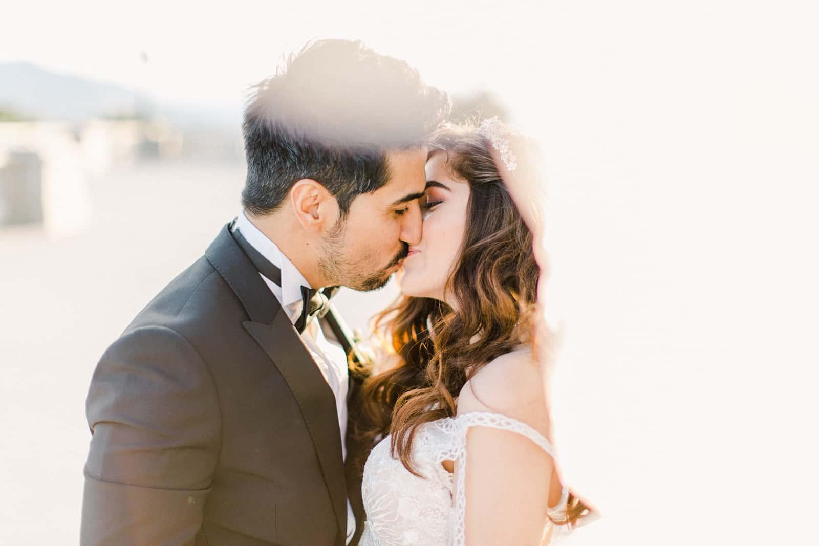 Palestinian Iranian Bride and Groom, Utah Wedding Photography at the Utah State Capitol, long veil kiss sunset light