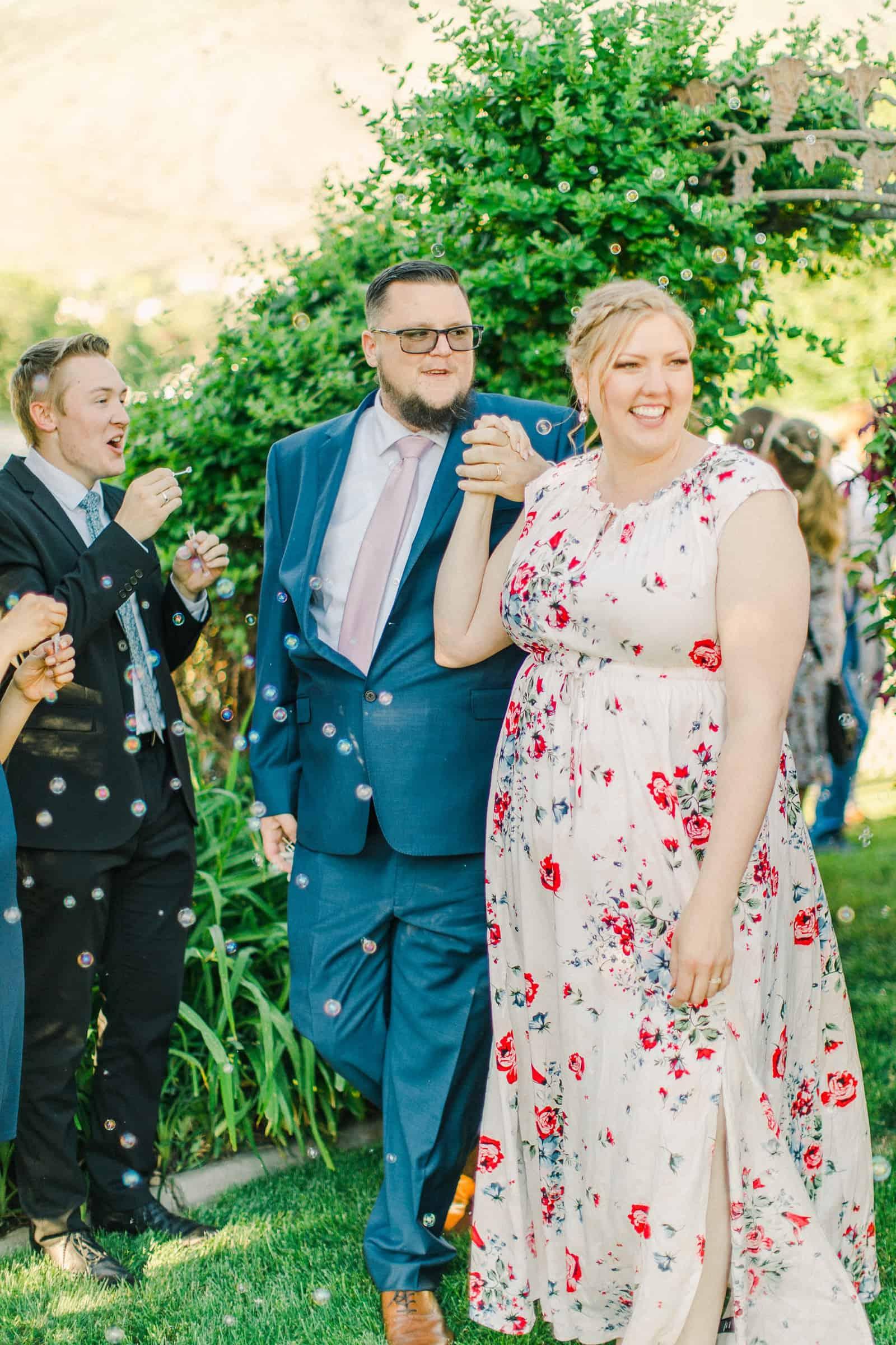 Draper LDS Temple Wedding, Utah wedding photography, summer backyard wedding, bride and groom grand send off exit bubbles