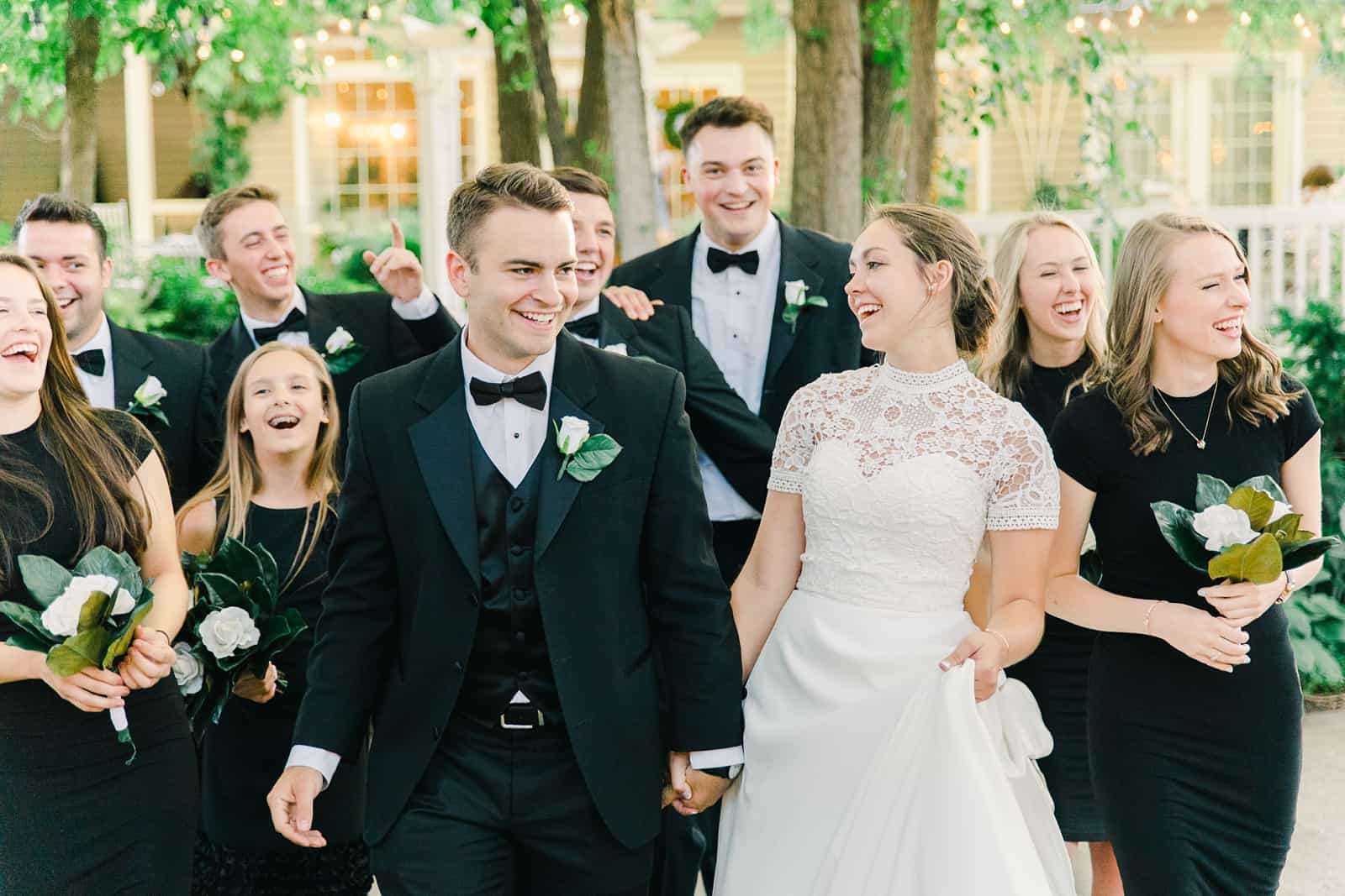 Clarion Gardens Utah Wedding, bride and groom laughing with bridal party, classic black tux with bow tie