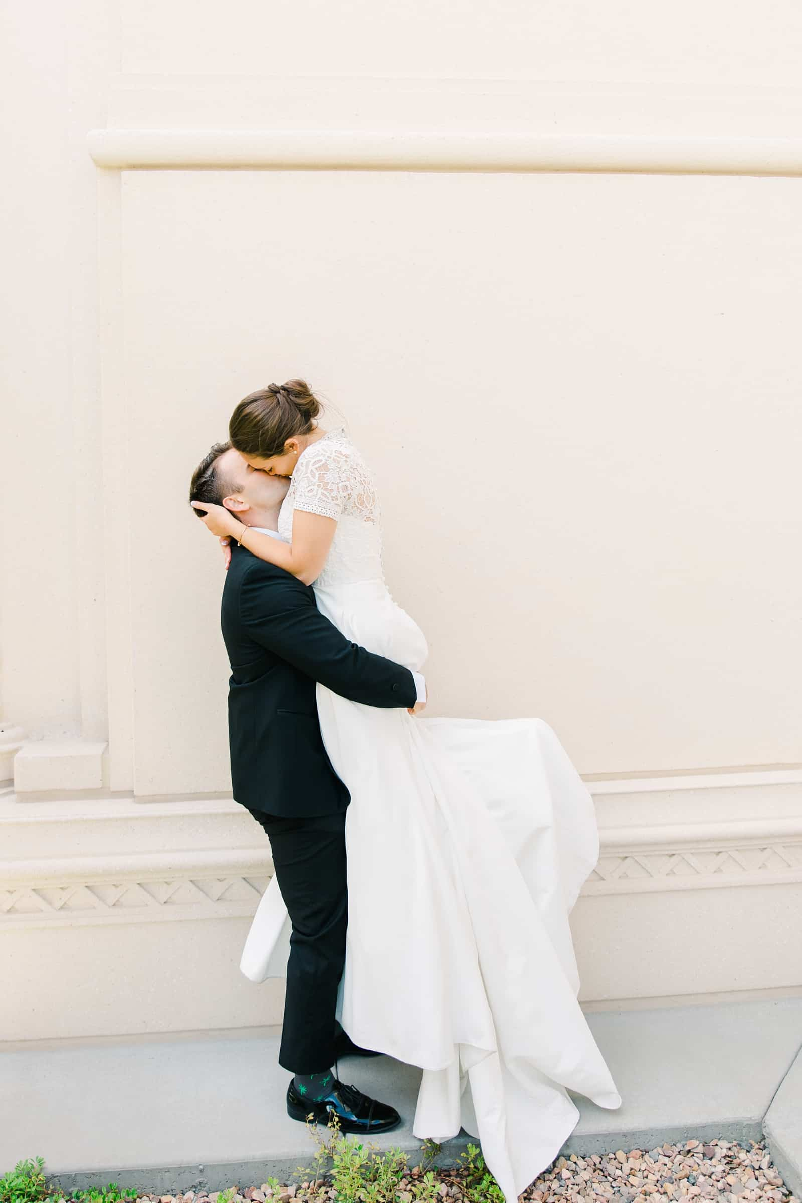 Payson Utah Temple wedding, bride and groom kiss