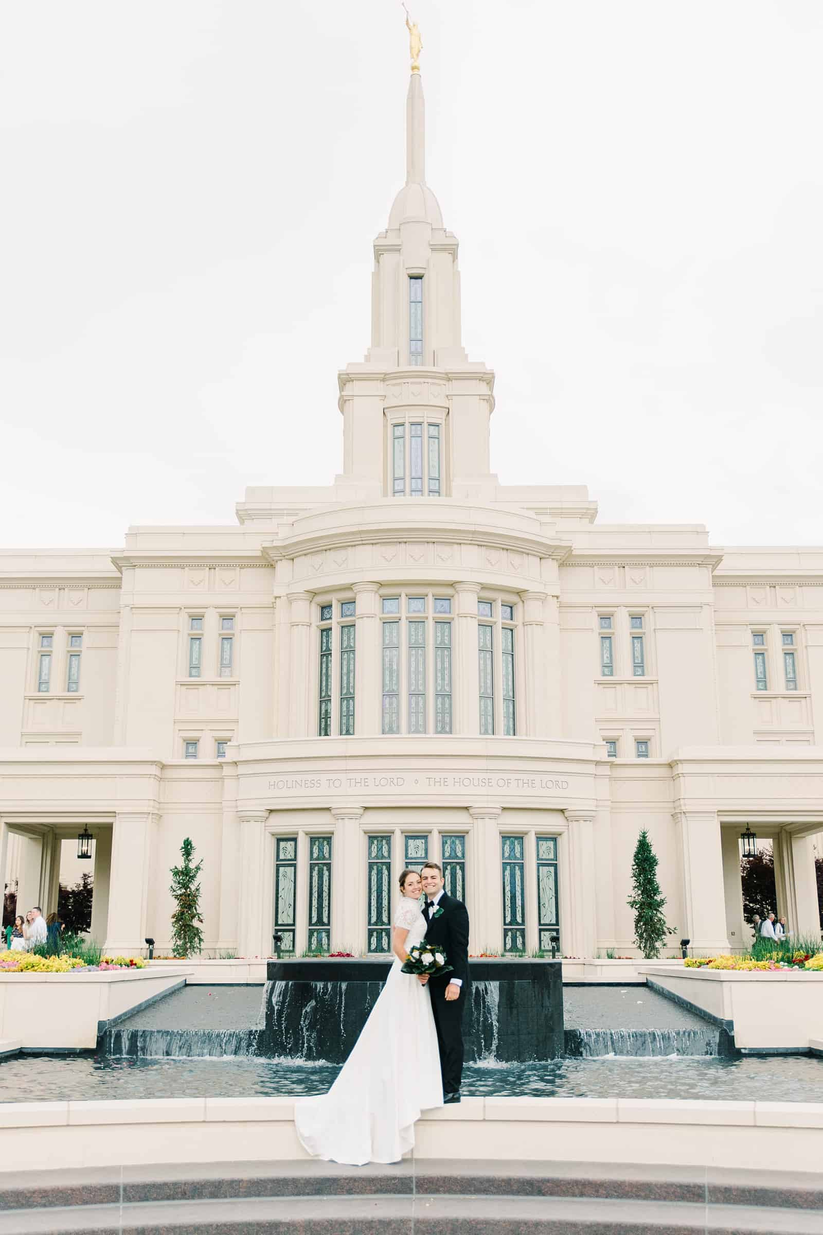 Payson Utah Temple wedding, bride and groom near fountain