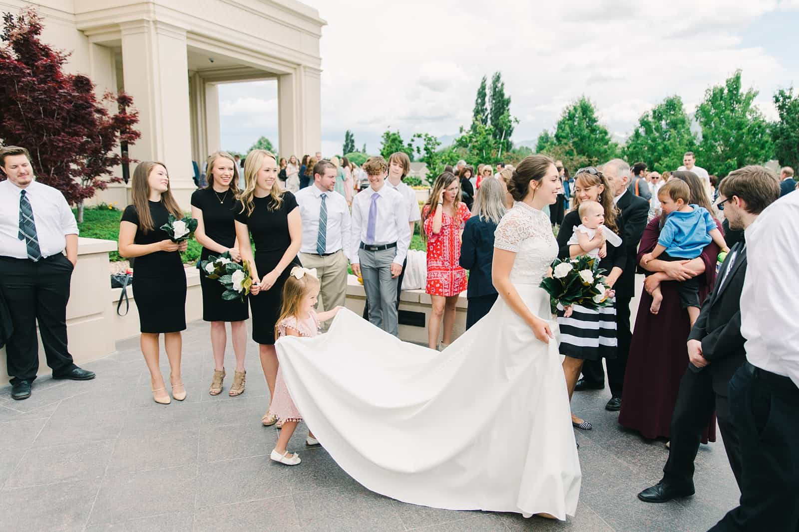 Payson Utah Temple wedding, flower girl holds bride's train