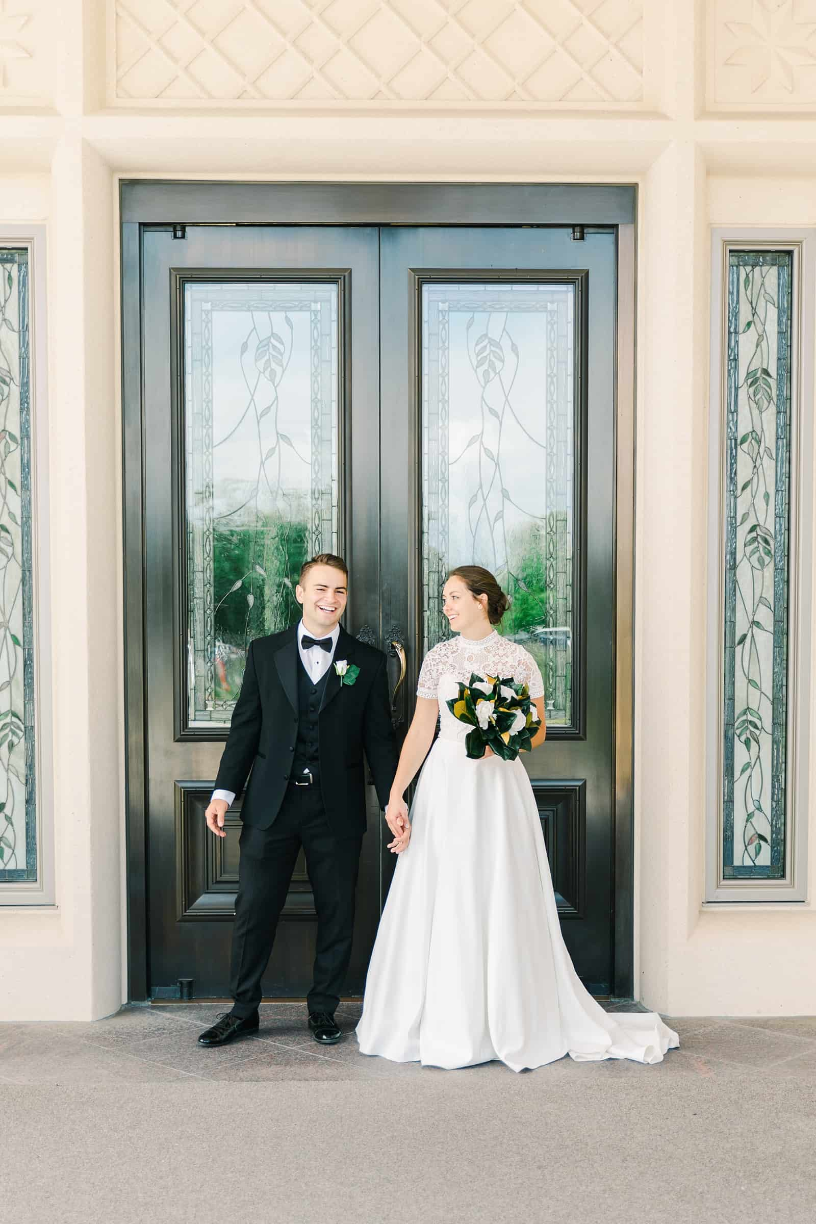 Payson Utah Temple wedding, bride and groom near temple doors