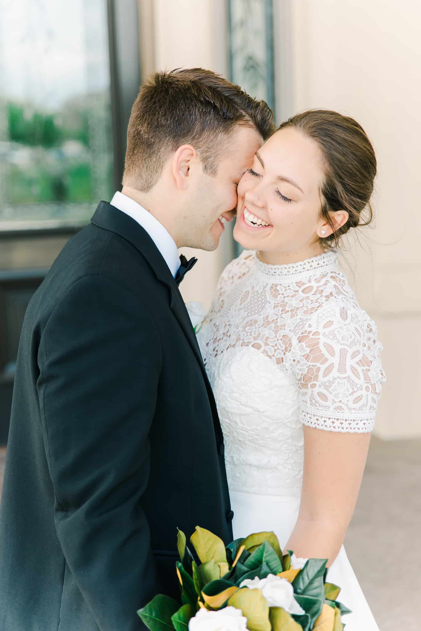 Payson Utah Temple wedding, bride laughing as groom kisses her cheek