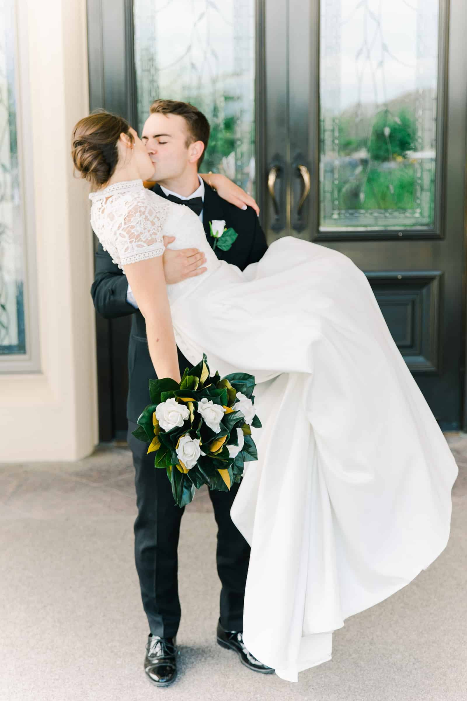 Payson Utah Temple wedding, groom carries bride
