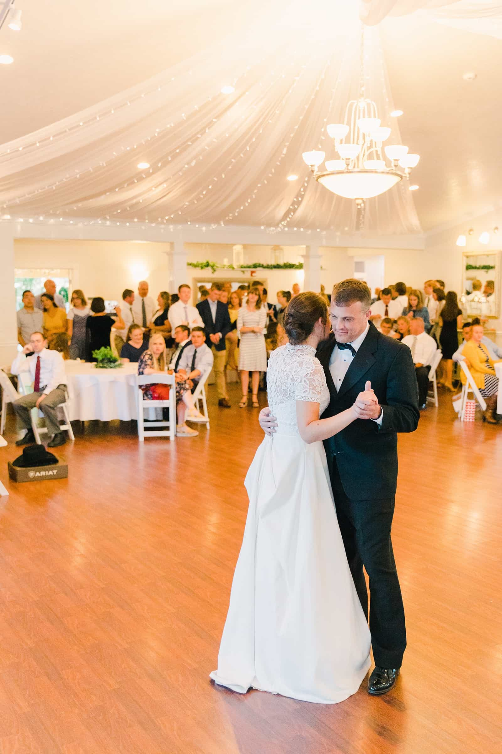 Clarion Gardens Payson Utah Wedding, bride dances with father of the bride