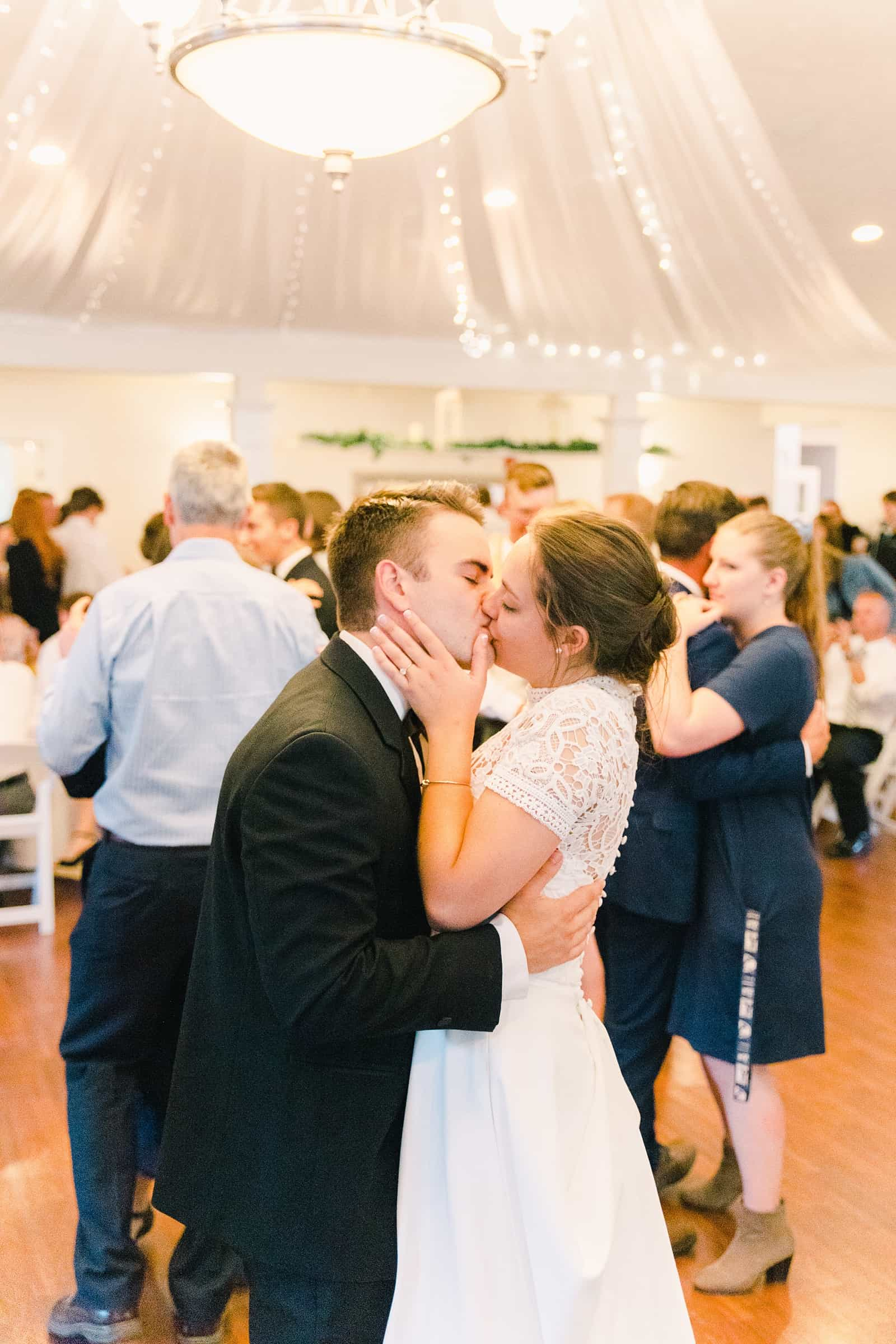 Clarion Gardens Payson Utah Wedding, bride and groom first dance kiss