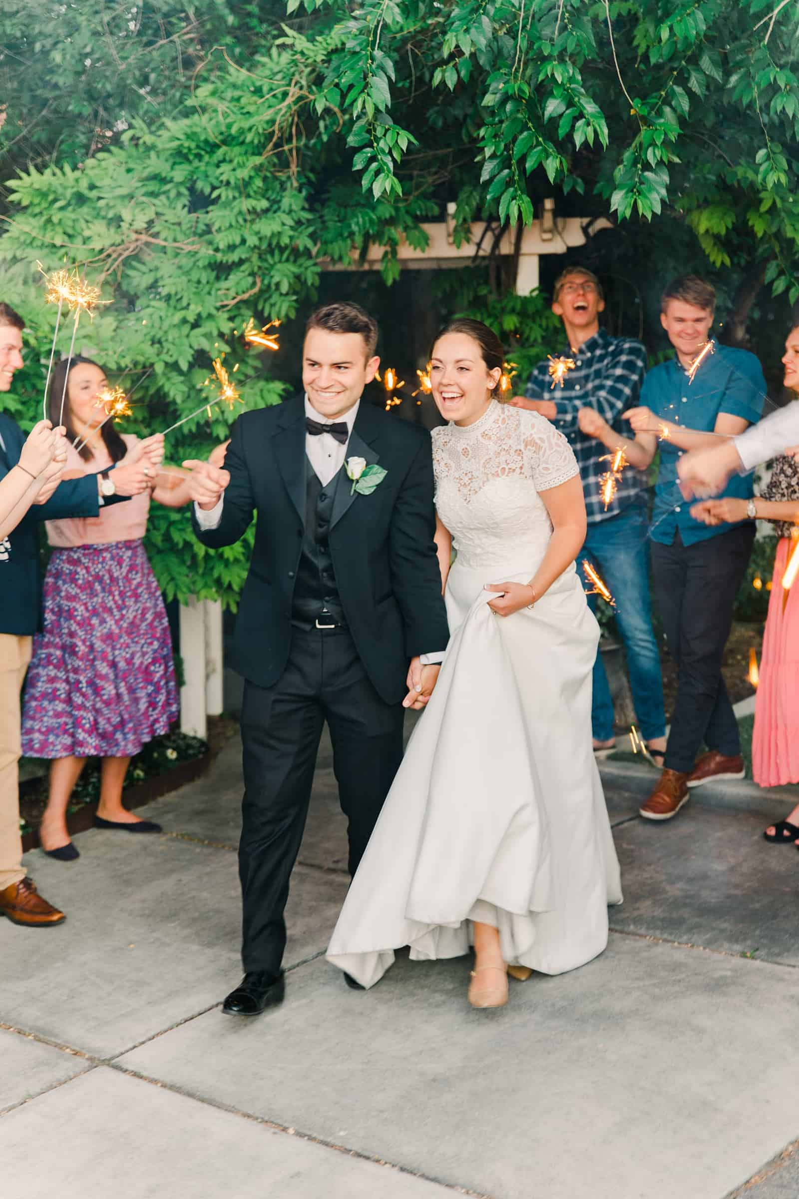 Clarion Gardens Payson Utah Wedding, bride and groom sparkler send off exit