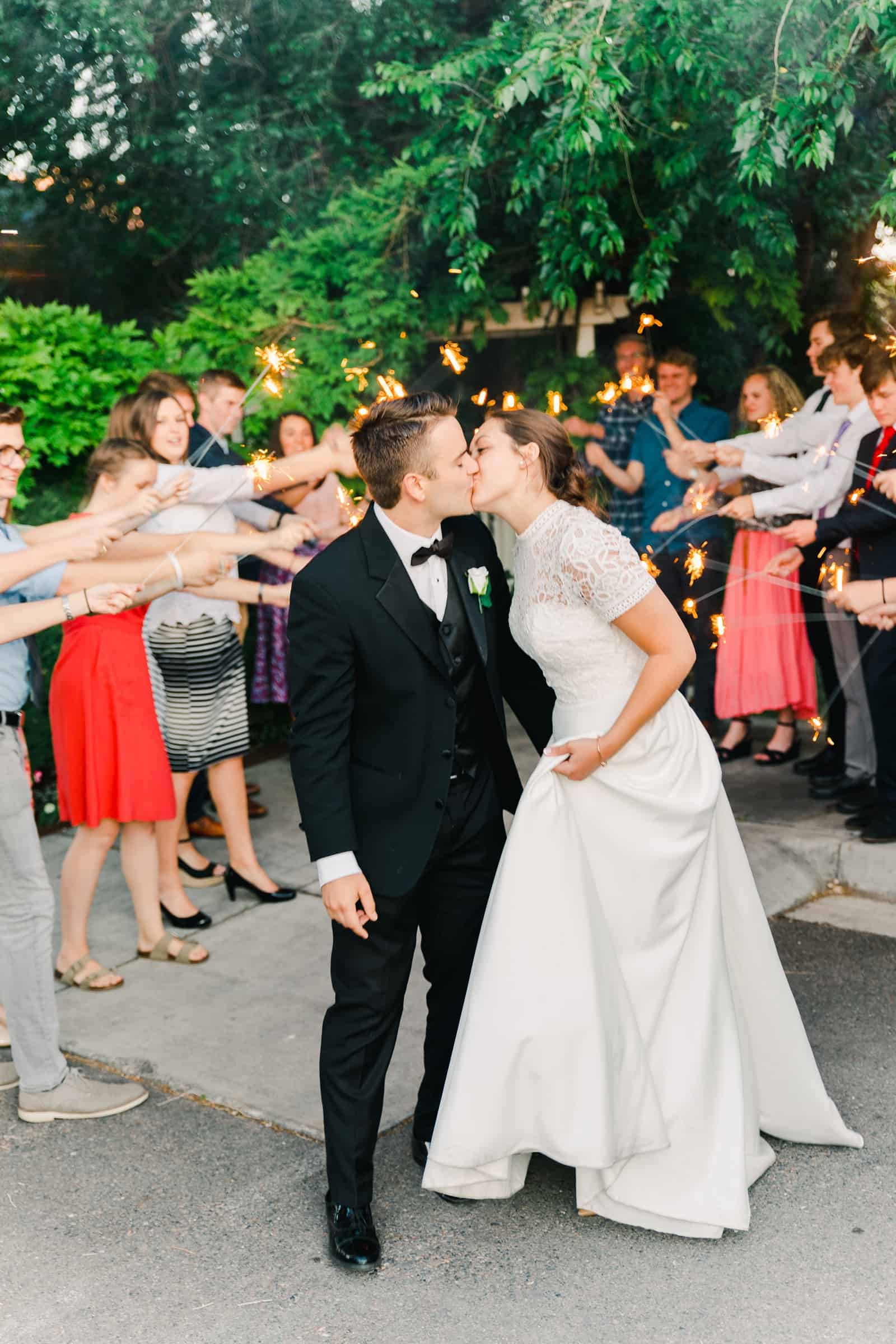 Clarion Gardens Payson Utah Wedding, bride and groom sparkler send off kiss