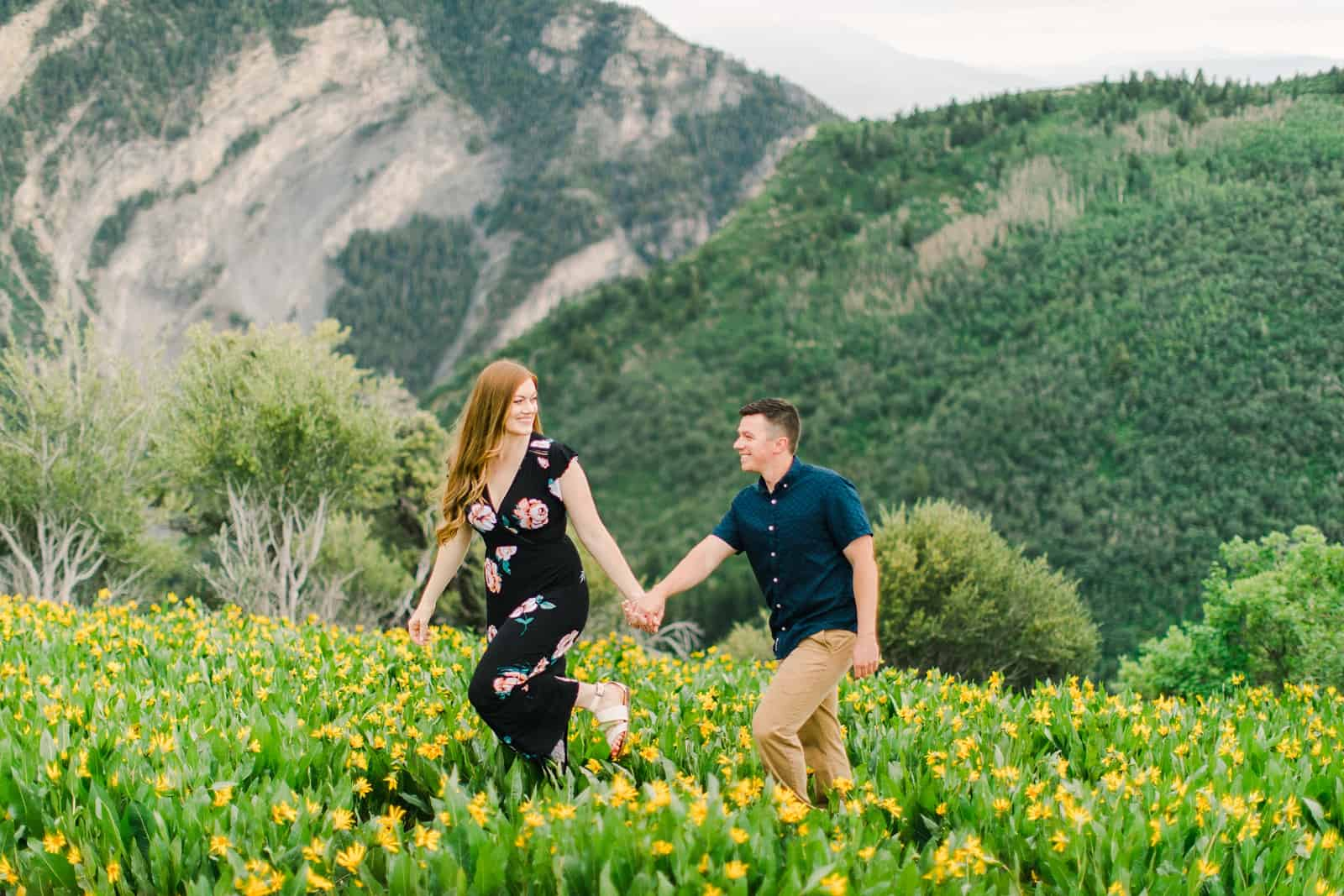 Provo Canyon wildflowers field engagement session, Utah wedding photography, engaged couple walking through the yellow flowers