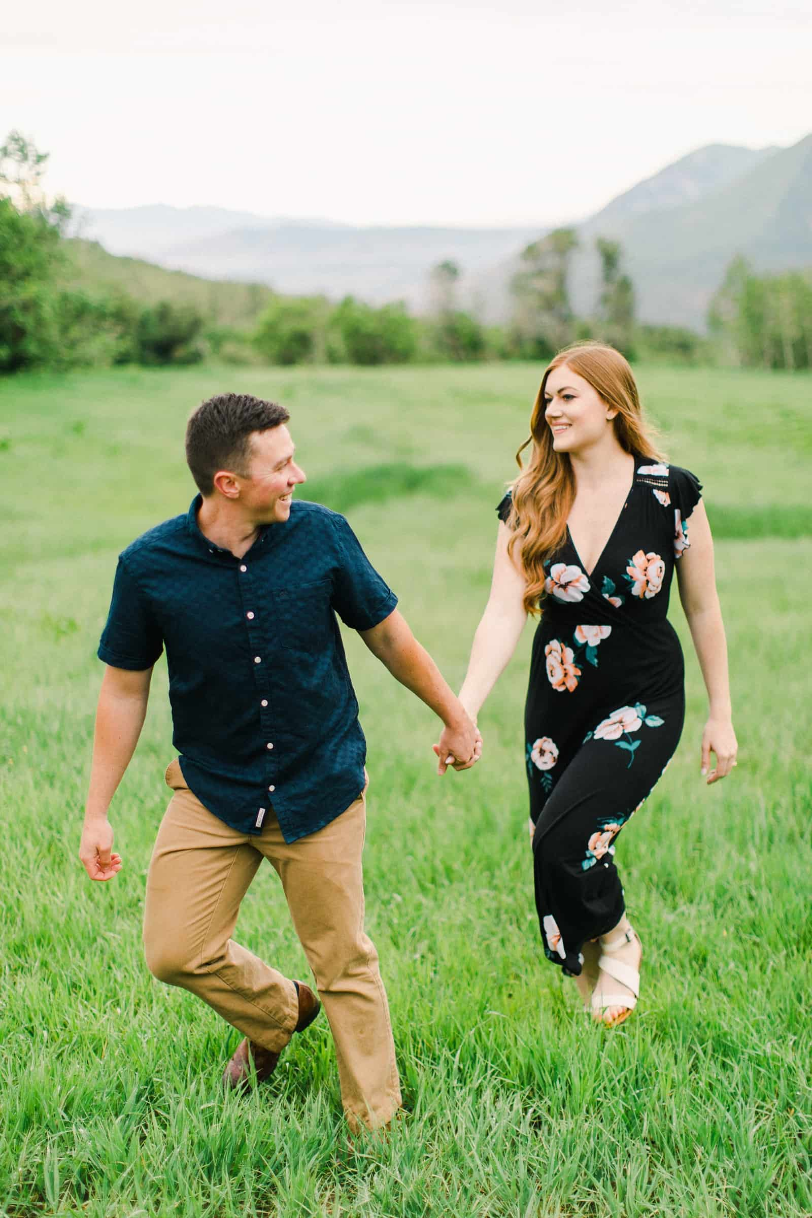 Provo Canyon wildflowers field engagement session, Utah wedding photography, engaged couple walking through grass