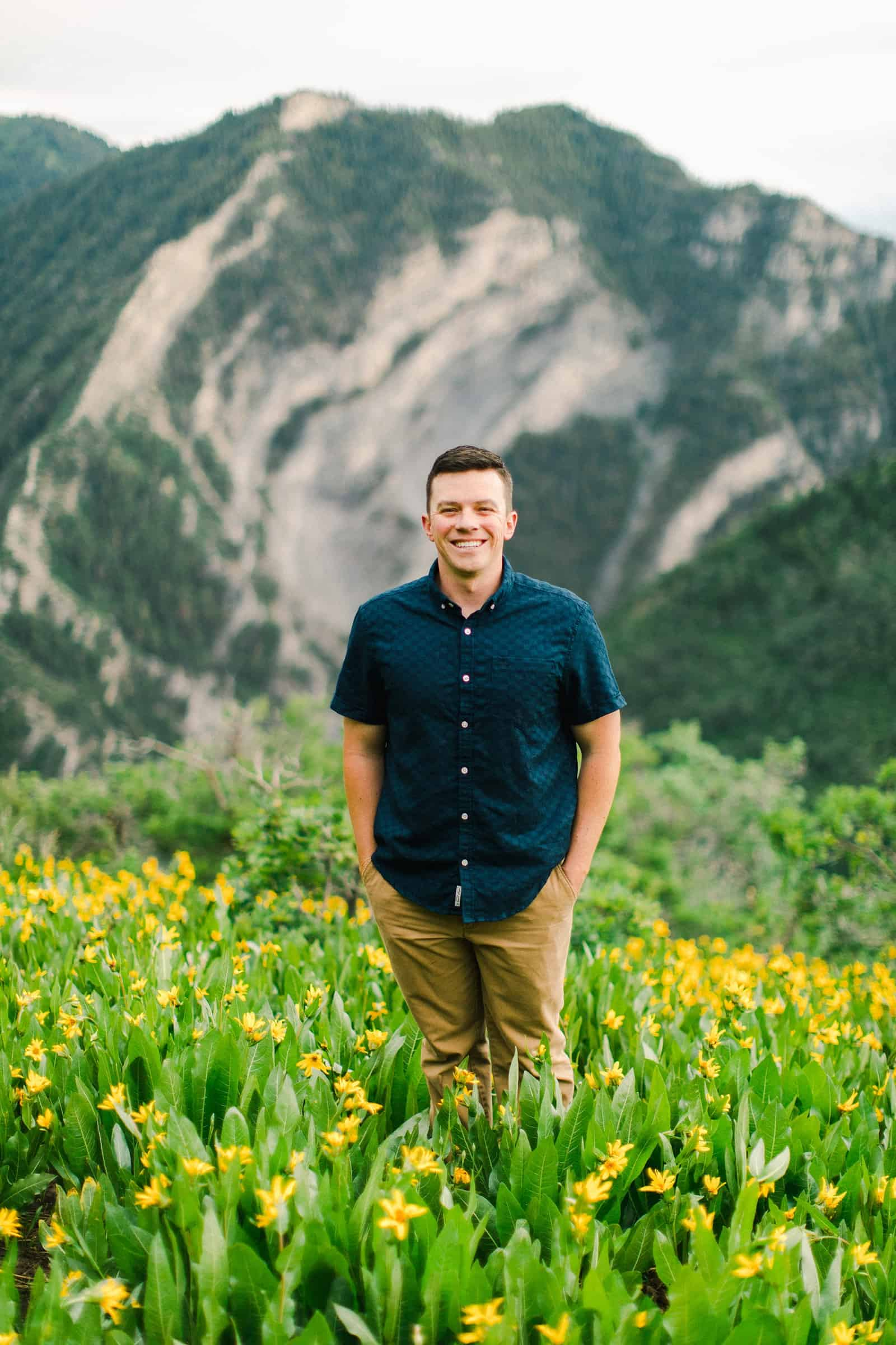 Provo Canyon wildflowers field engagement session, Utah wedding photography, groom in dark blue button up shirt and khaki pants