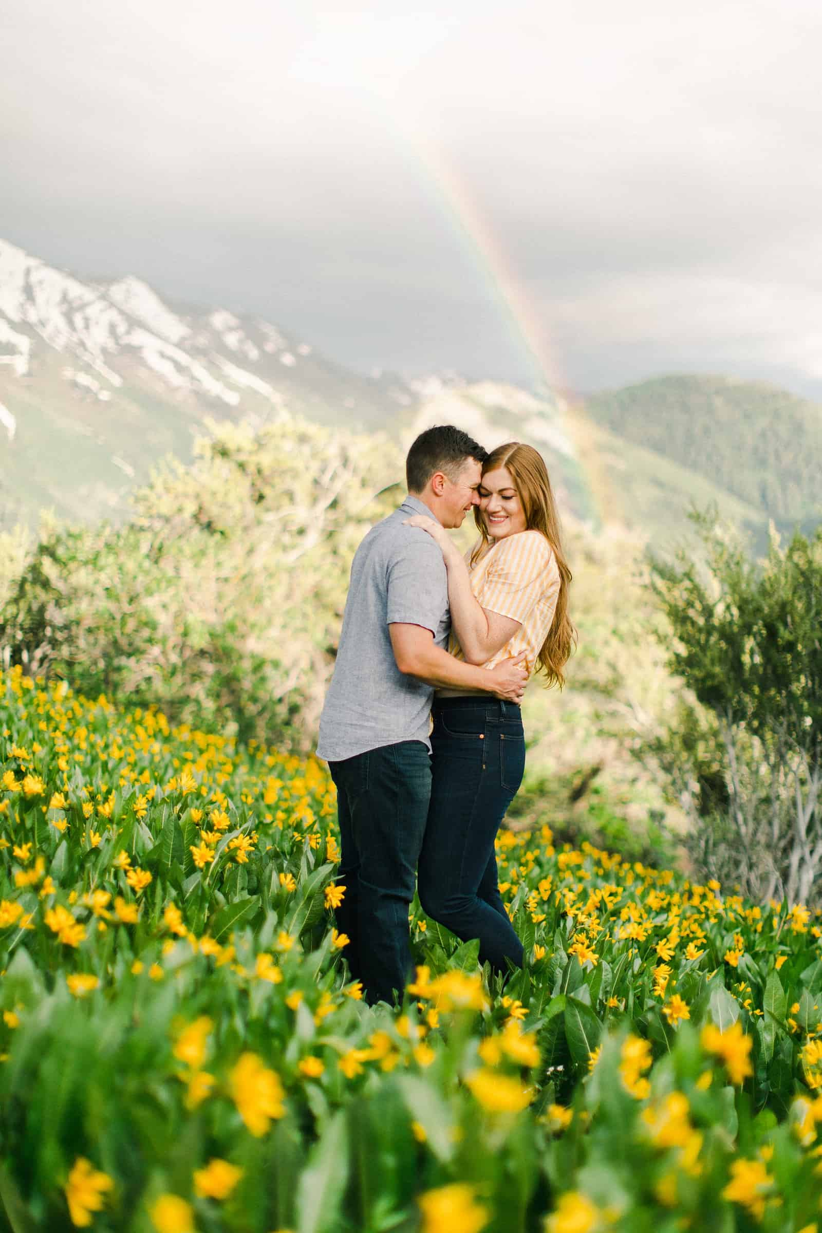 Provo Canyon wildflowers field engagement session, Utah wedding photography, engaged couple in yellow flowers and mountains with rainbow in background