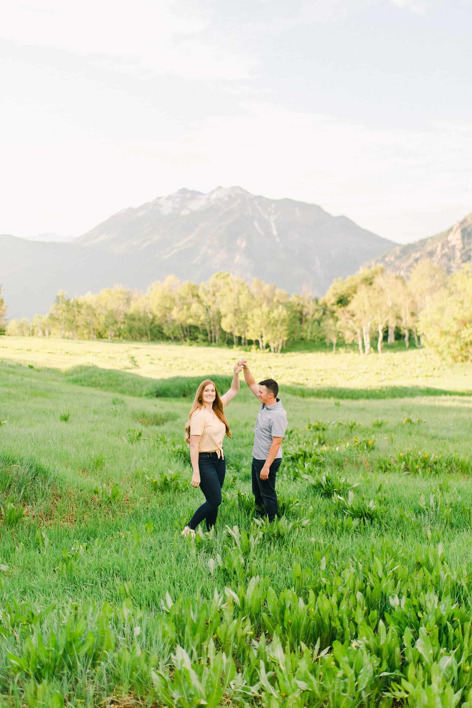 Provo Canyon wildflowers field engagement session, Utah wedding photography, engaged couple dancing in yellow flowers and mountains