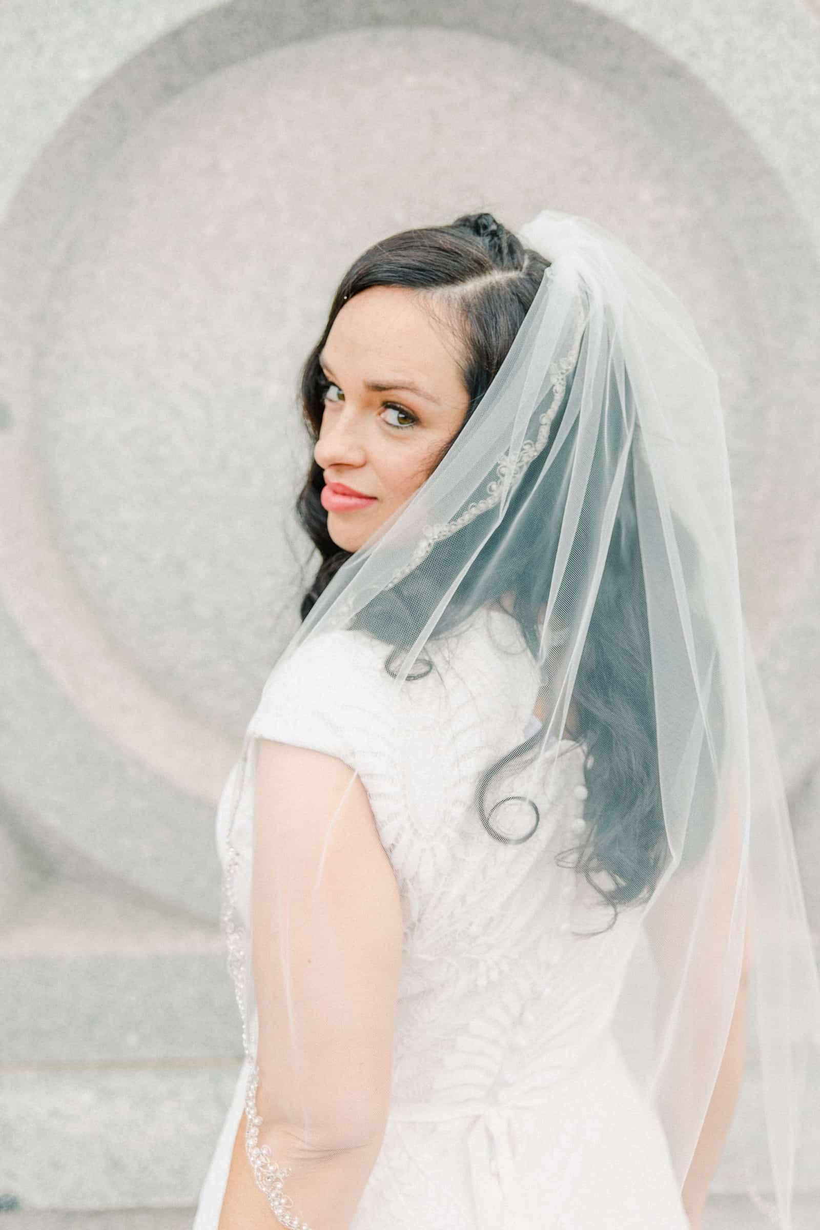 Thomas S. Monson Center Wedding, Salt Lake LDS Temple Wedding, Utah wedding photography. bride in modest lace wedding dress with long fingertip veil