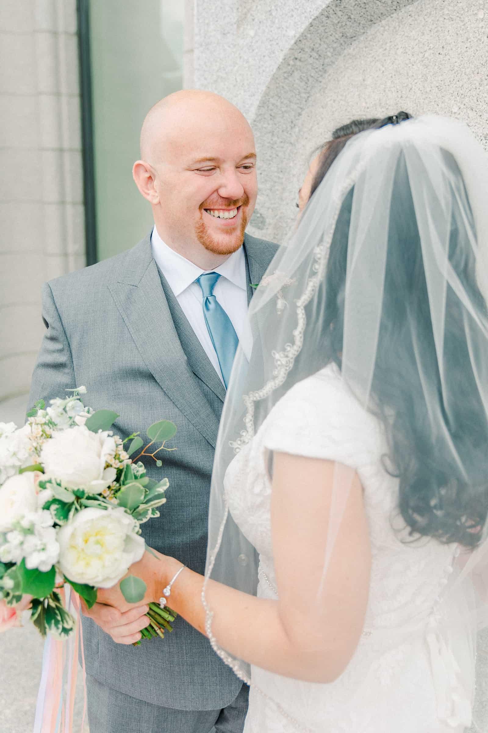 Thomas S. Monson Center Wedding, Salt Lake LDS Temple Wedding, Utah wedding photography. groom in light gray suit and blue tie