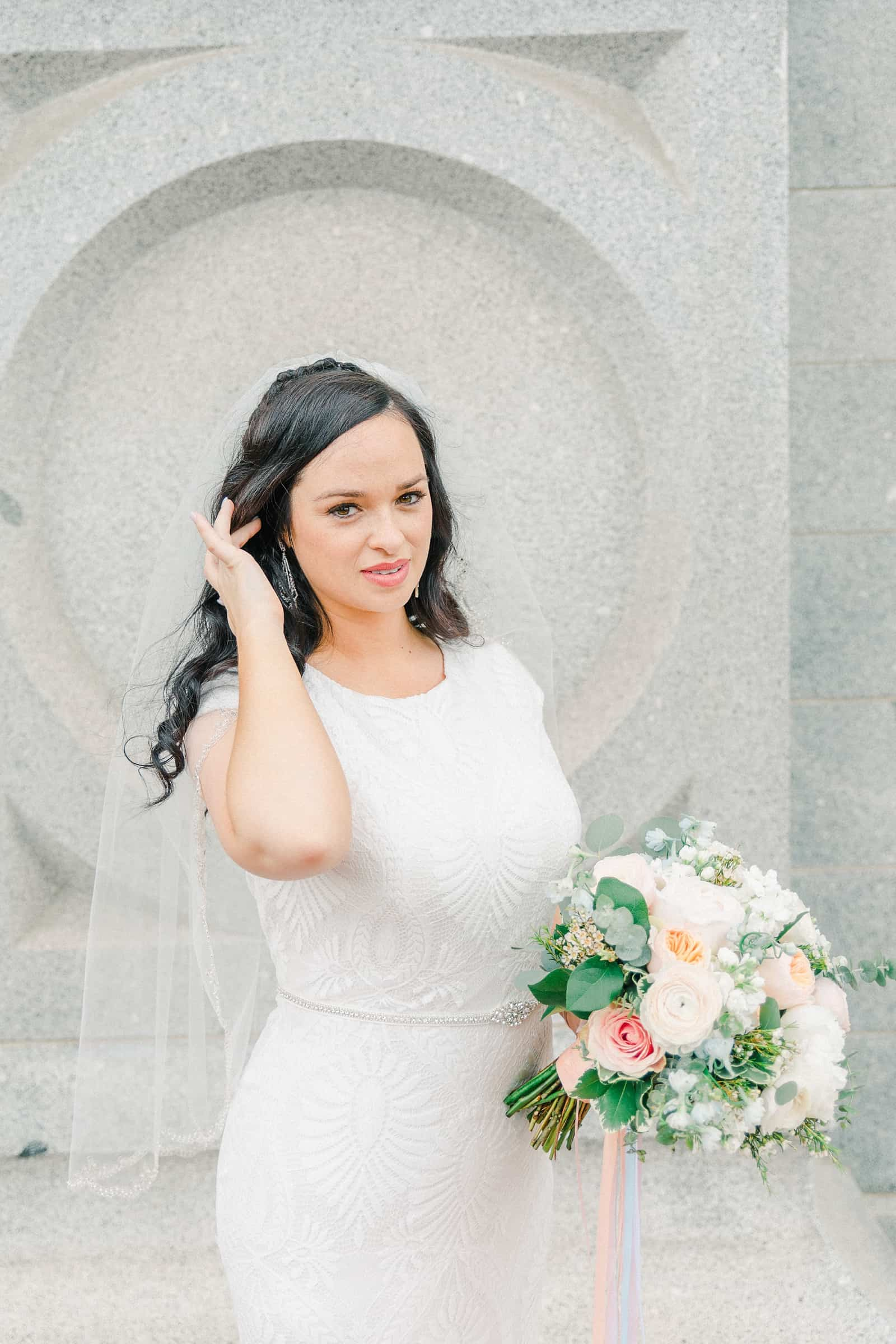 Thomas S. Monson Center Wedding, Salt Lake LDS Temple Wedding, Utah wedding photography. bride in modest lace wedding dress with veil, pink and white flowers wedding bouquet