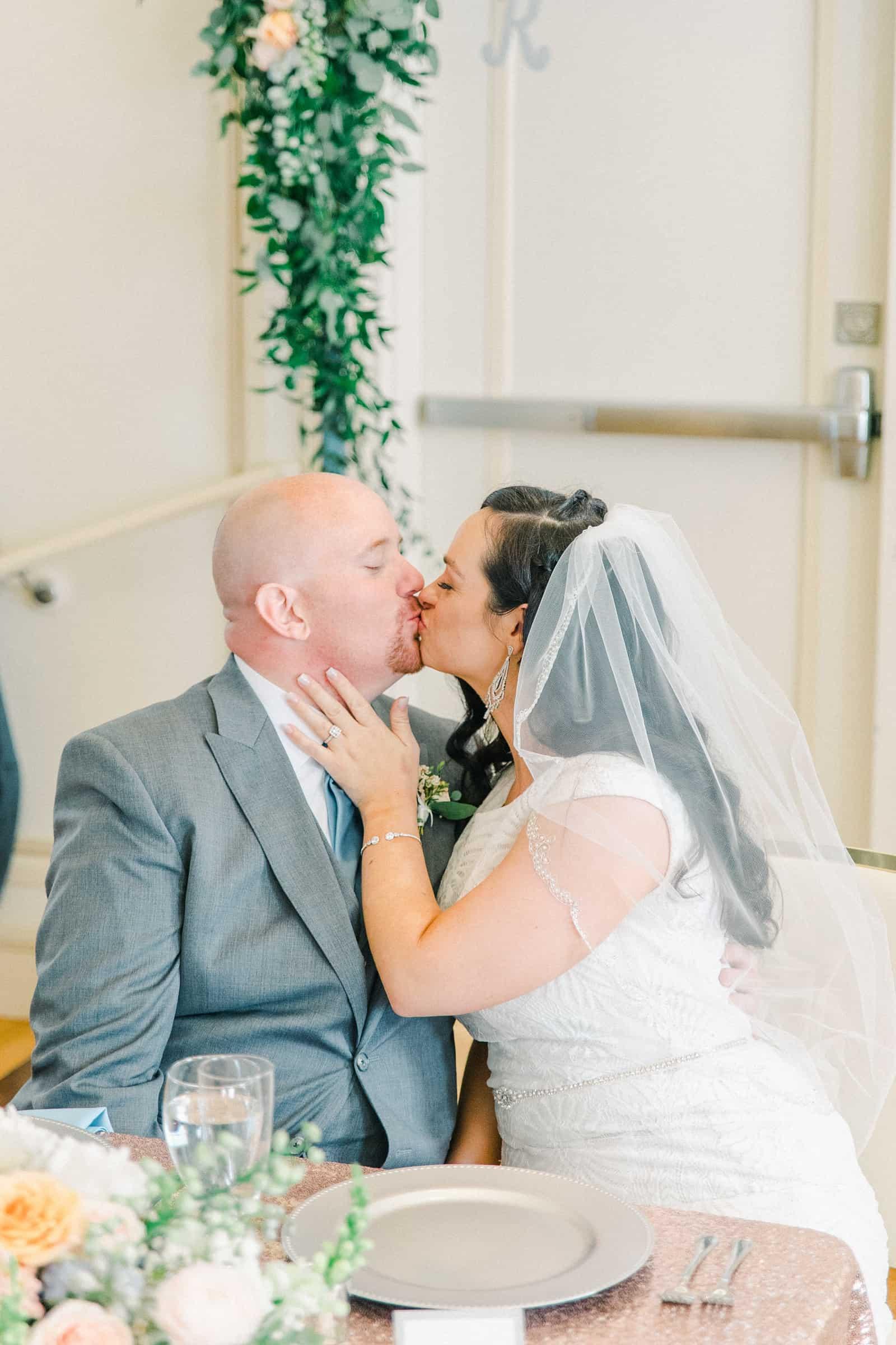 Thomas S. Monson Center Wedding, Salt Lake LDS Temple Wedding, Utah wedding photography, bride and groom kiss