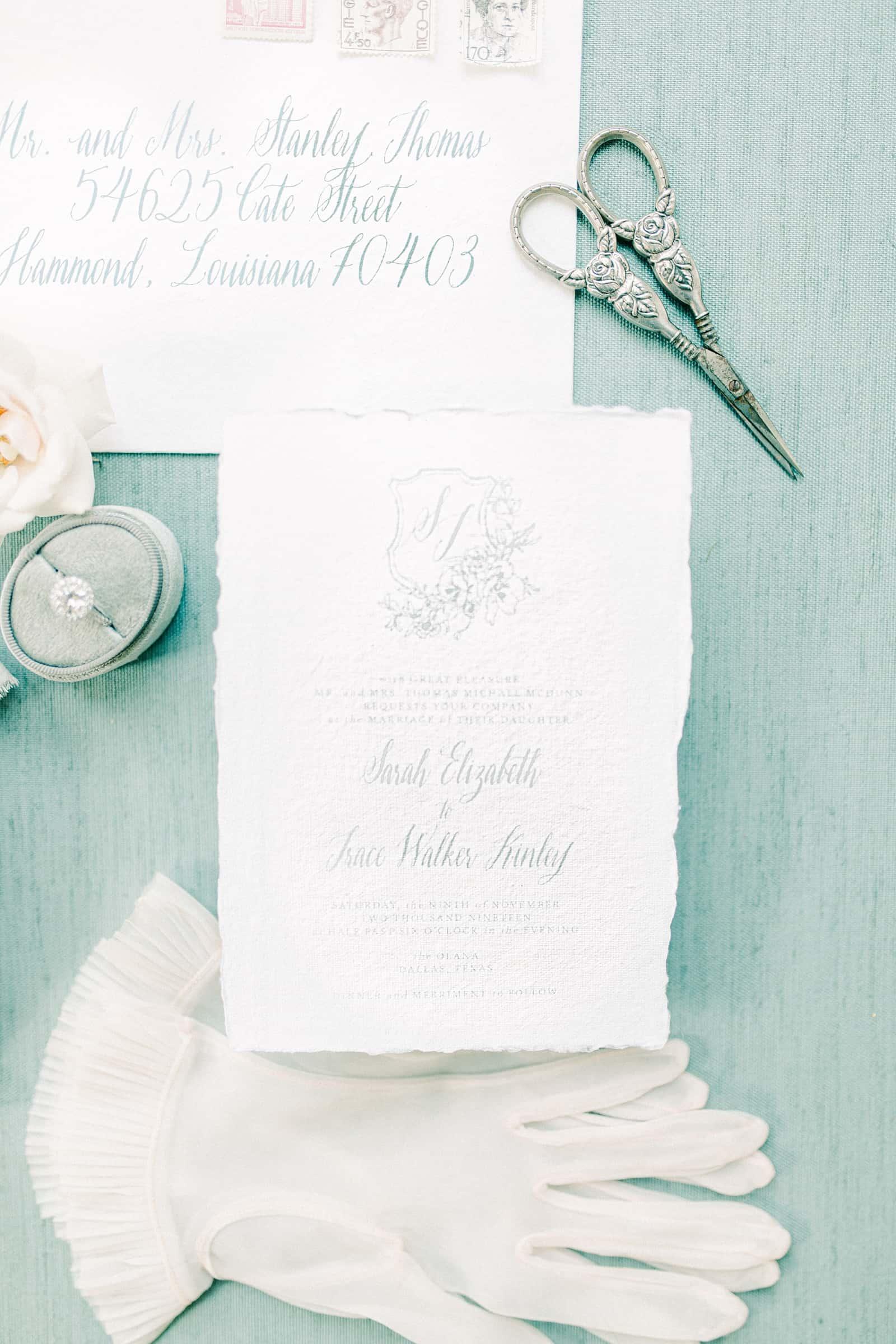 Fine art sketched European style wedding invitations on light blue background
