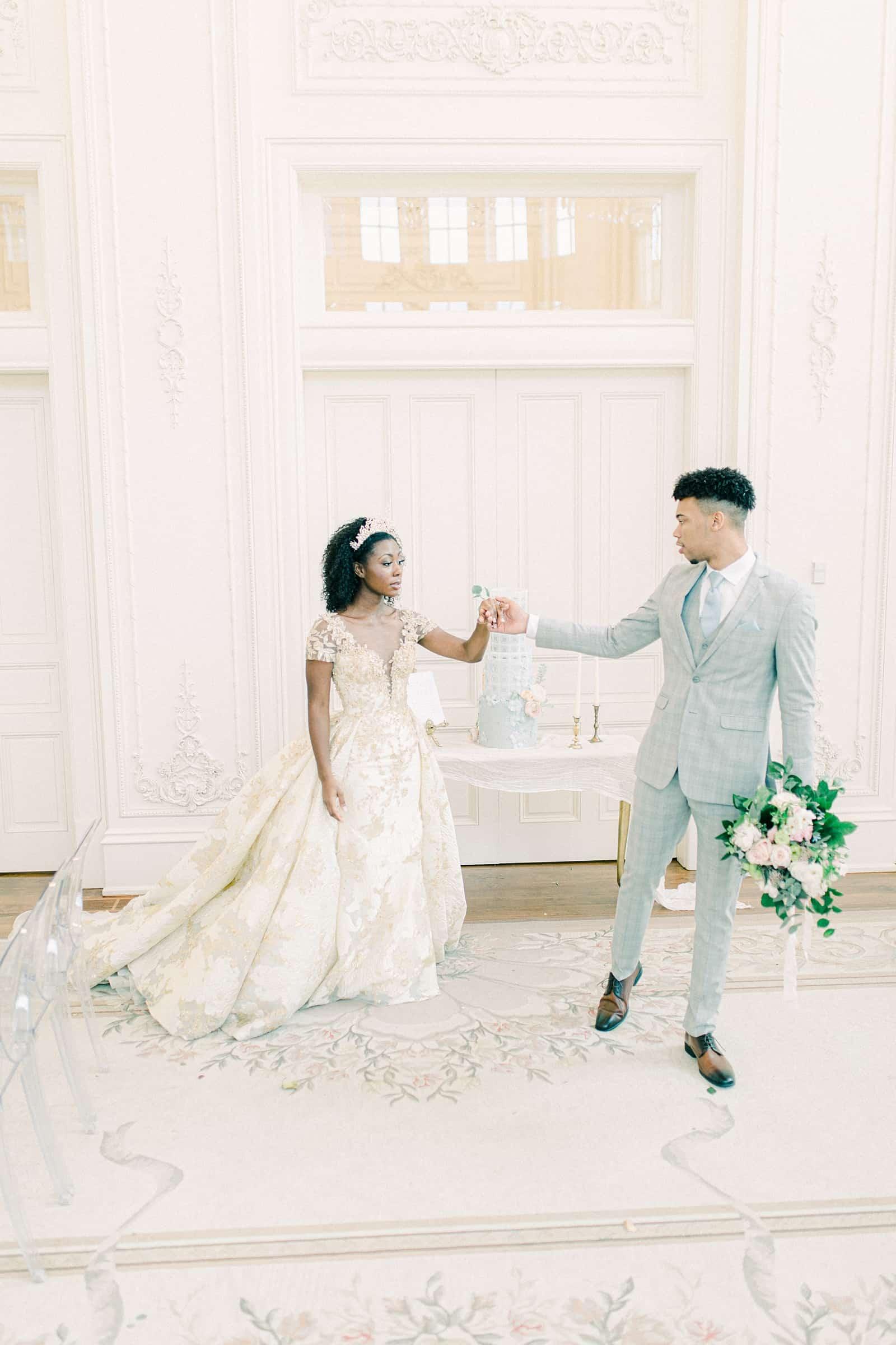 Fairytale bride and groom in all white ballroom, elegant wedding