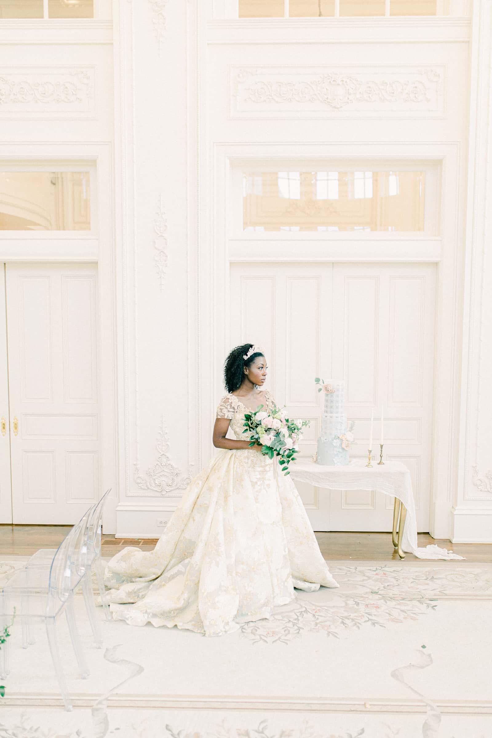Disney princess bride with tiara in all white ballroom, elegant high end wedding