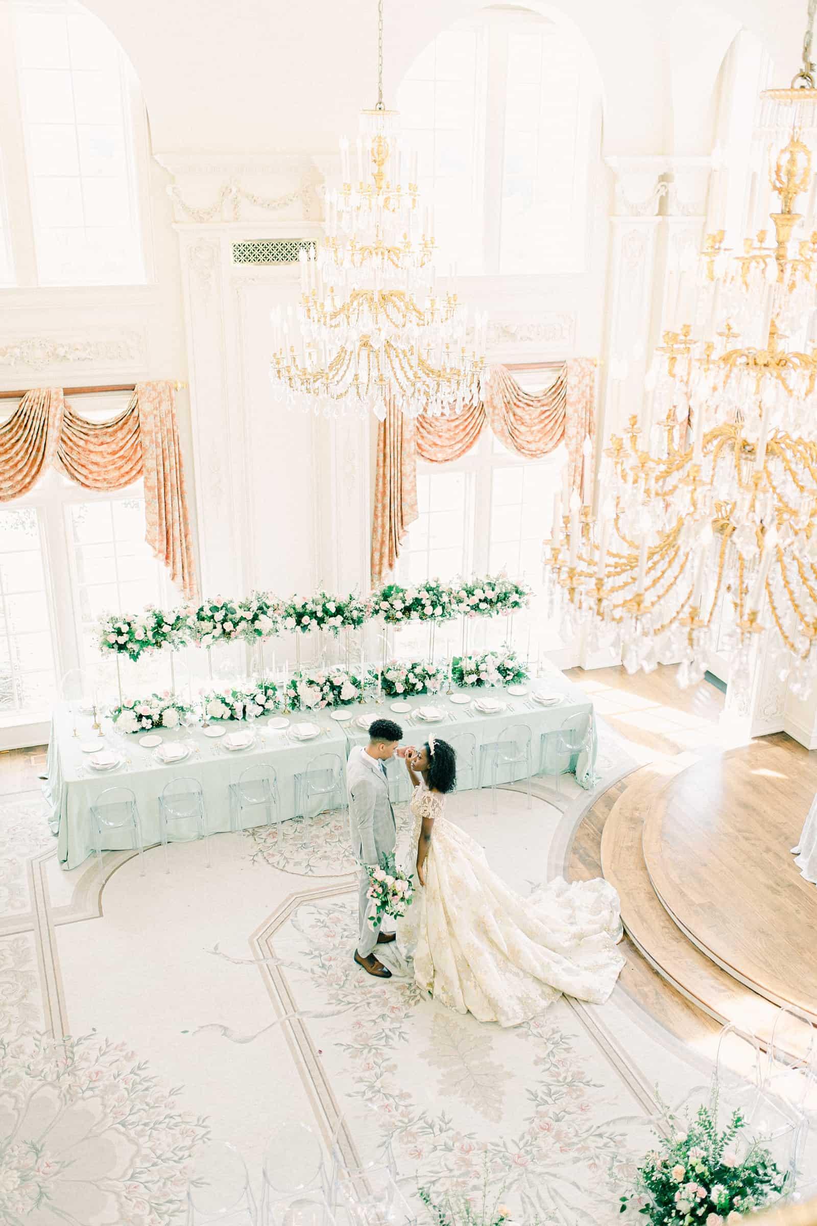 Bride and groom ballroom wedding with light blue at the Olana in Dallas, Texas, Disney princess wedding chandelier