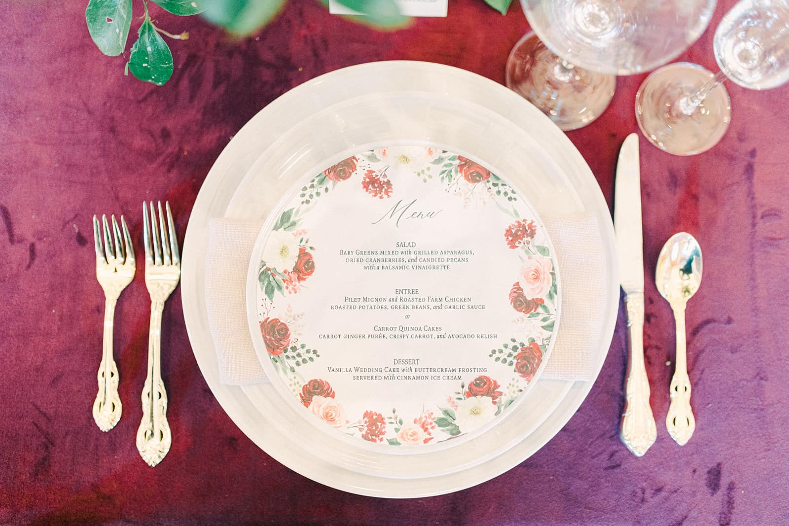Red tablecloth with floral round wedding menu