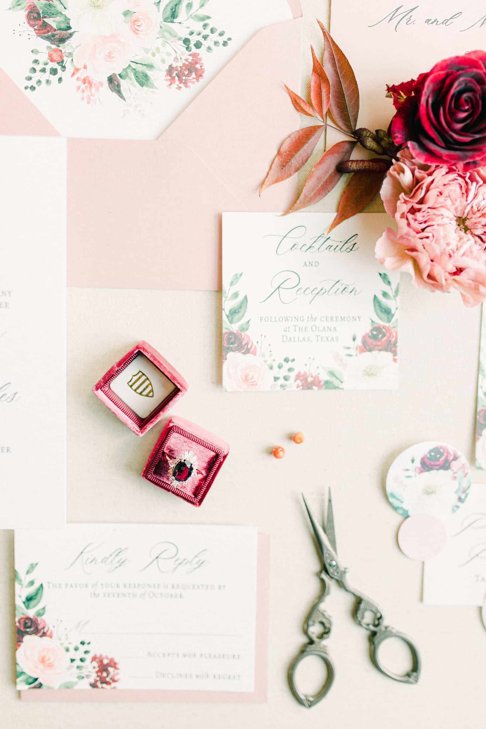 Vintage ruby engagement wedding ring, floral wedding invitations on blush pink background
