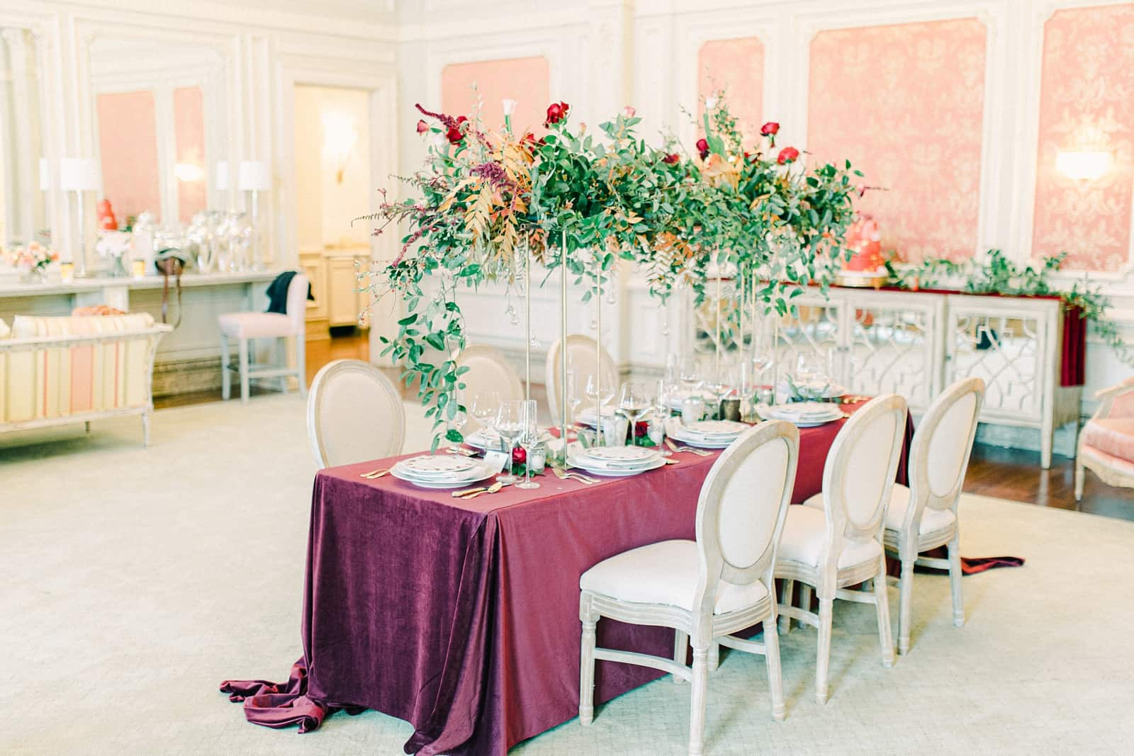 Maroon tablecloth, wedding table with tall geometric centerpieces