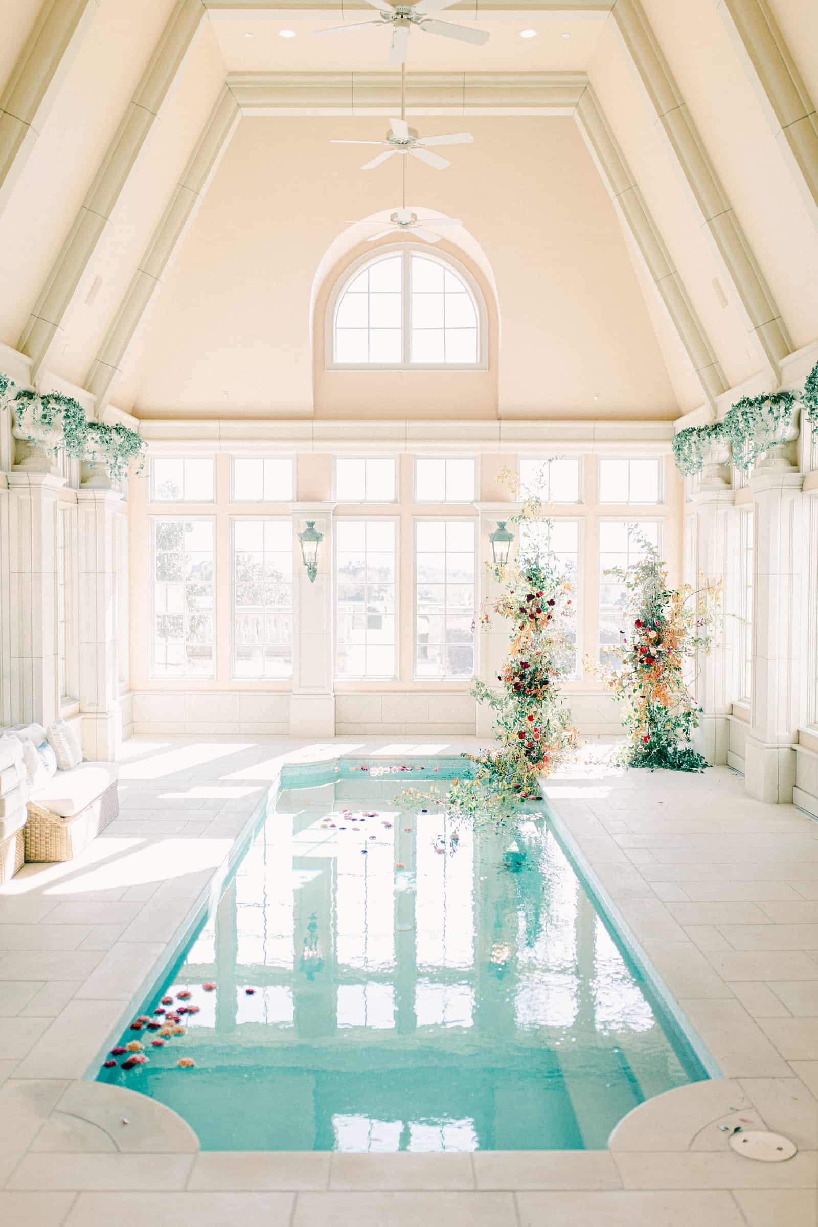 Elegant poolhouse wedding with floral ceremony backdrop