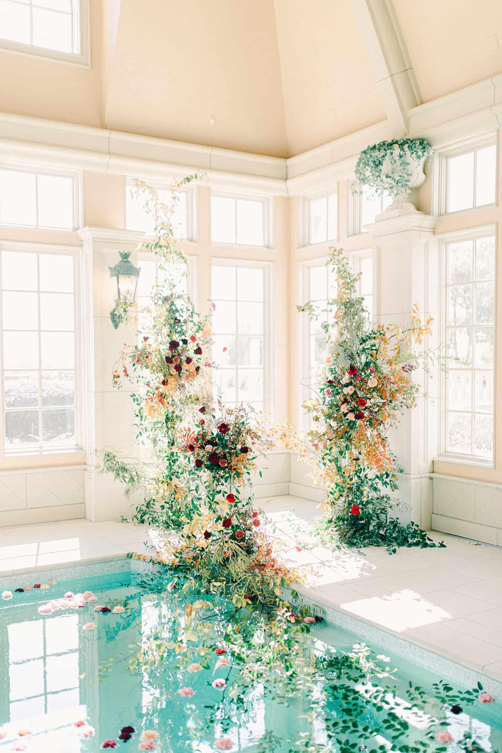 Ornate floral backdrop for elegant European wedding ceremony at the Olana in Dallas, Texas