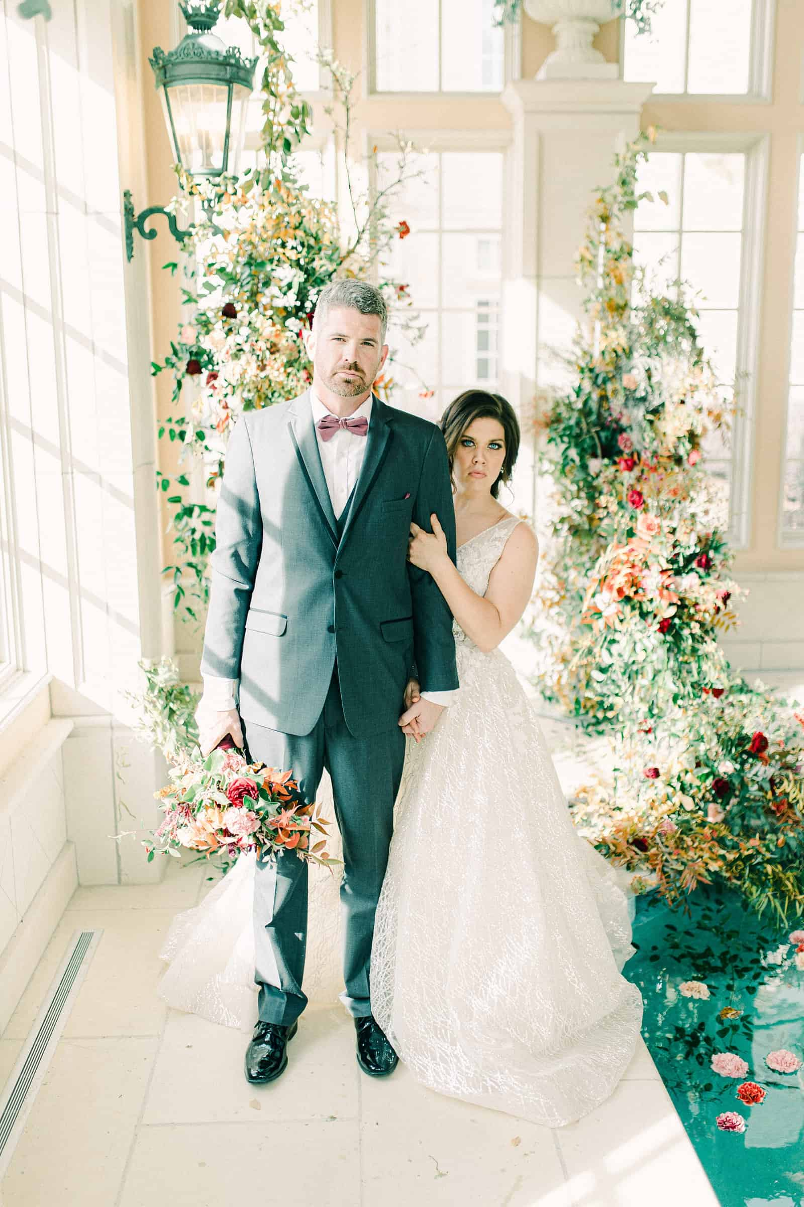 French-inspired wedding at the Olana mansion in Dallas, Texas, bride and groom with ceremony backdrop