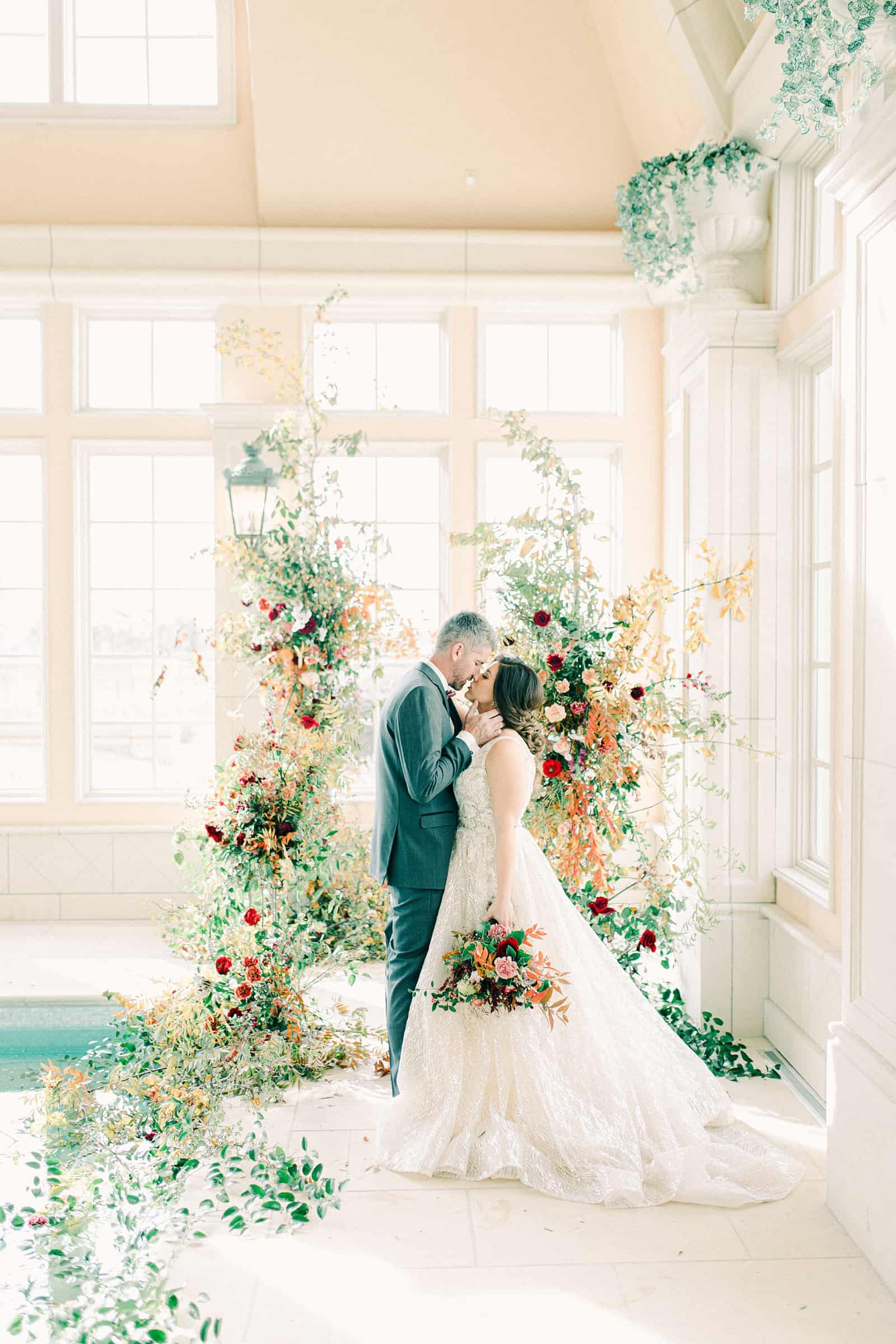 French-inspired wedding at the Olana mansion in Dallas, Texas, pool house ceremony, bride and groom with ceremony backdrop