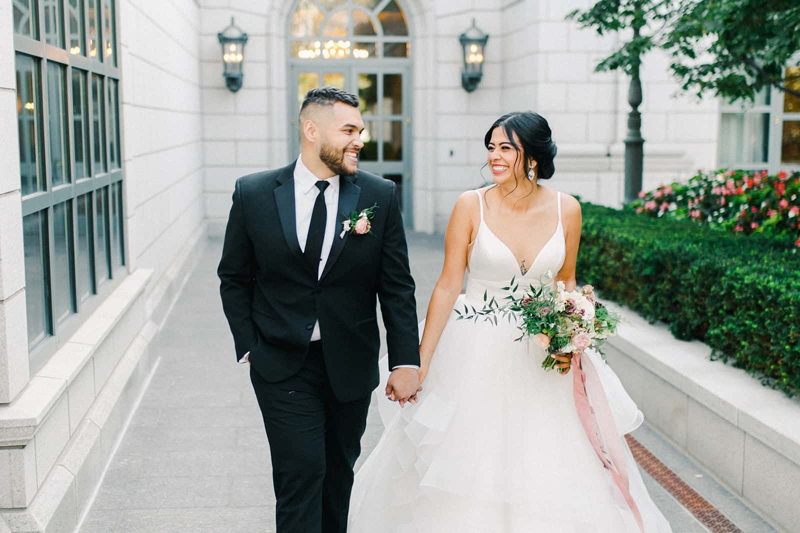 Bride and groom laughing at the Grand America Hotel wedding