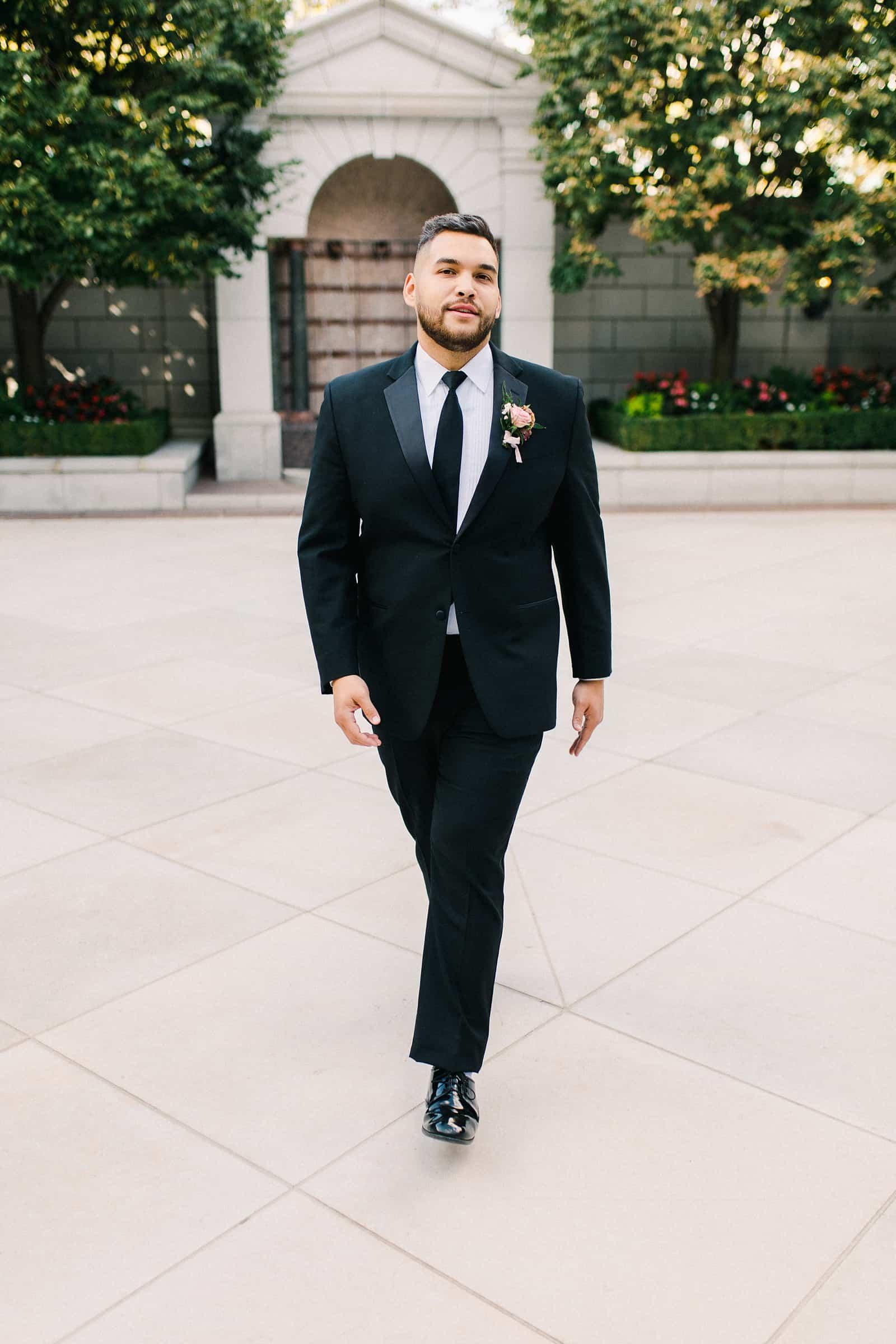 Groom wearing classic black tuxedo