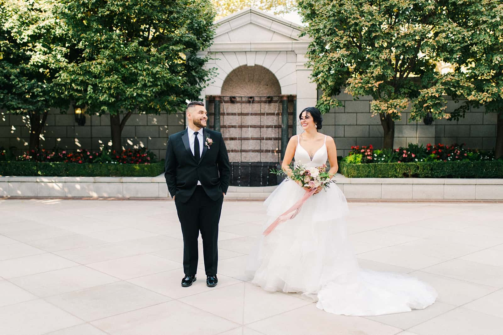 Bride and groom on their wedding day at the Grand America Hotel
